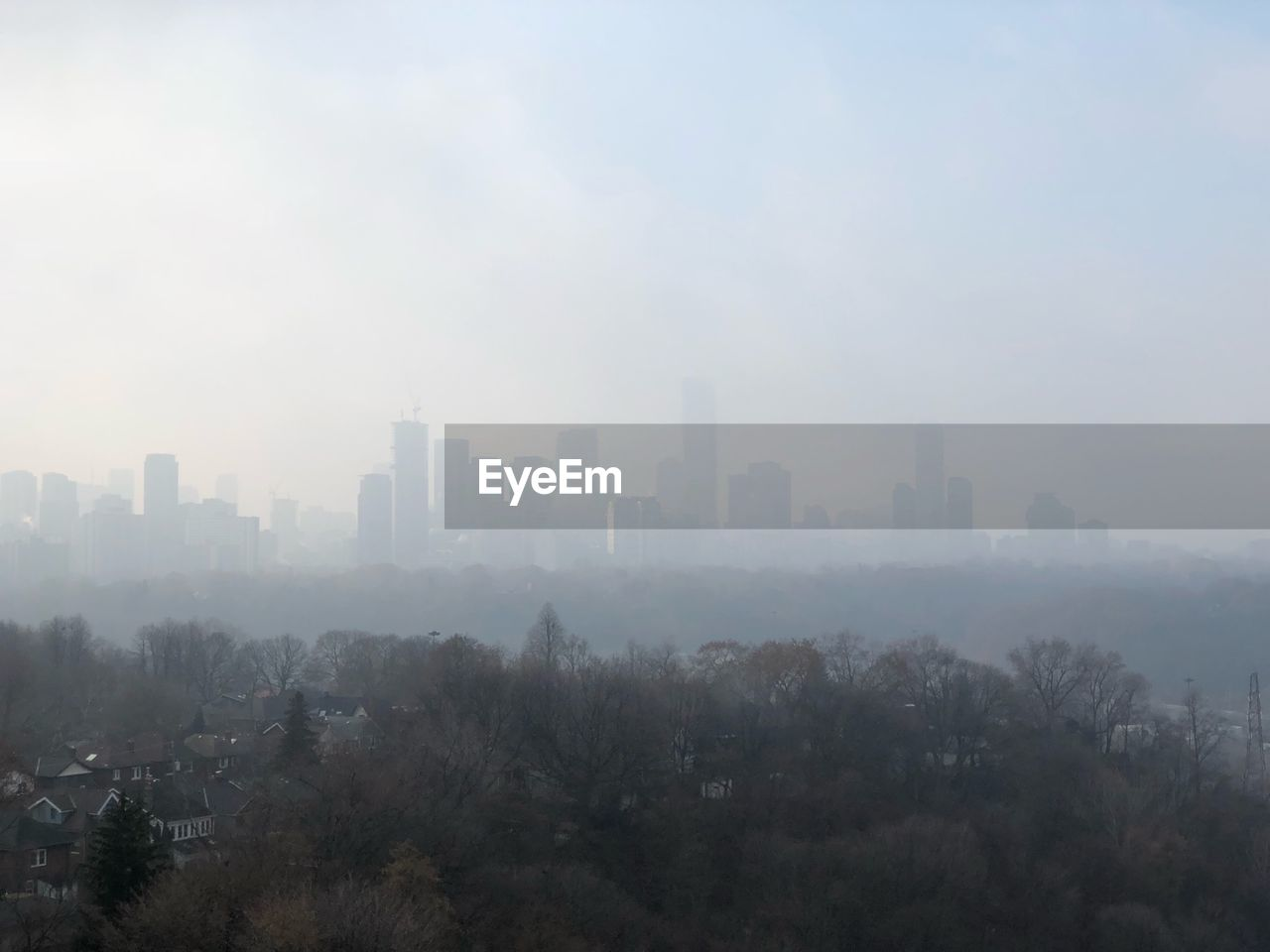 fog, skyscraper, cityscape, architecture, city, mist, no people, building exterior, day, outdoors, travel destinations, tall, nature, tree, urban skyline, sky