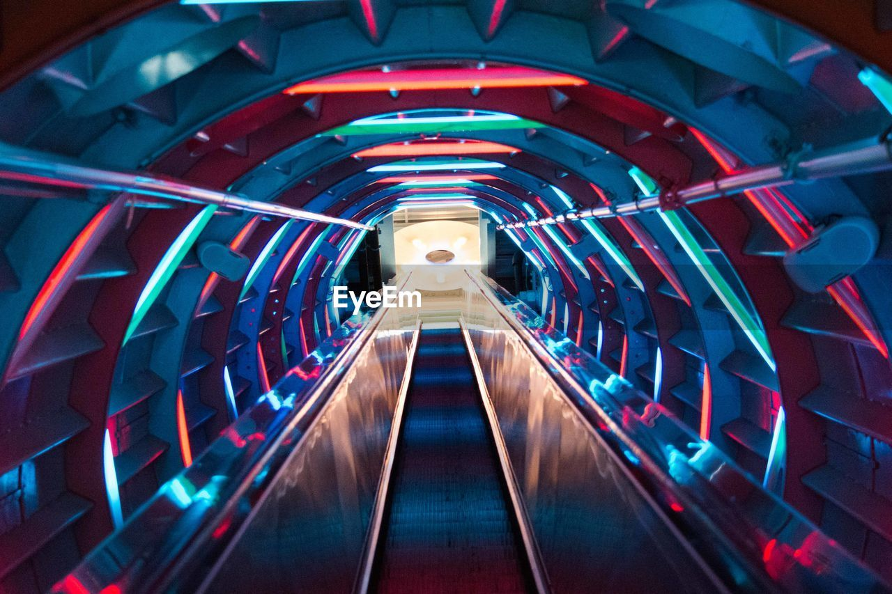Moving Walkway With Colorful Lights In Tunnel