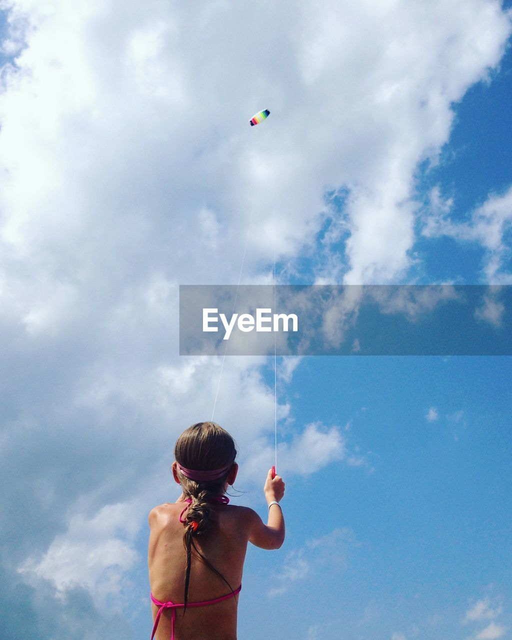 Rear view of girl flying kite