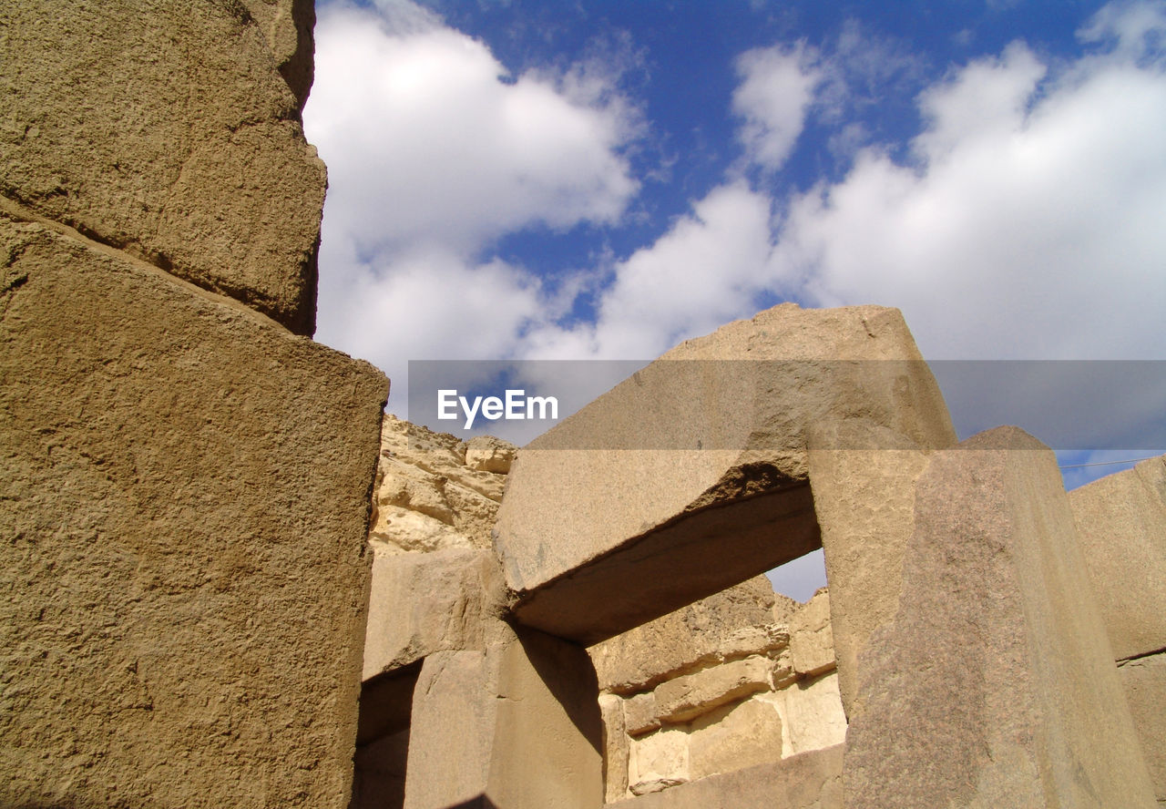 built structure, history, architecture, low angle view, the past, ancient, sky, cloud - sky, day, ancient civilization, old ruin, no people, building exterior, outdoors, sunlight, travel destinations, pyramid, close-up