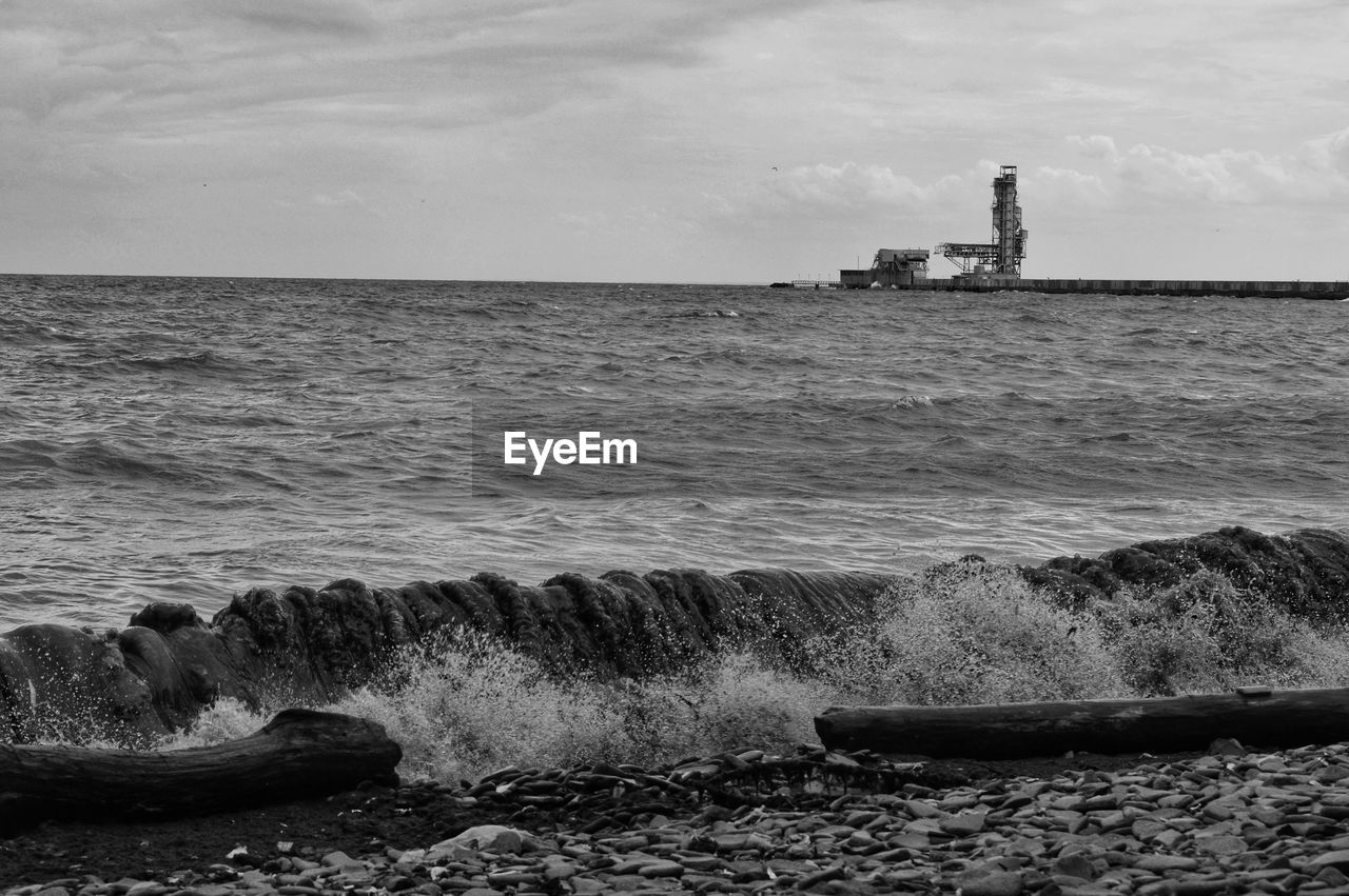 water, sky, sea, horizon, cloud - sky, nature, scenics - nature, beach, horizon over water, motion, beauty in nature, no people, land, day, rock, guidance, outdoors, wave, solid, groyne
