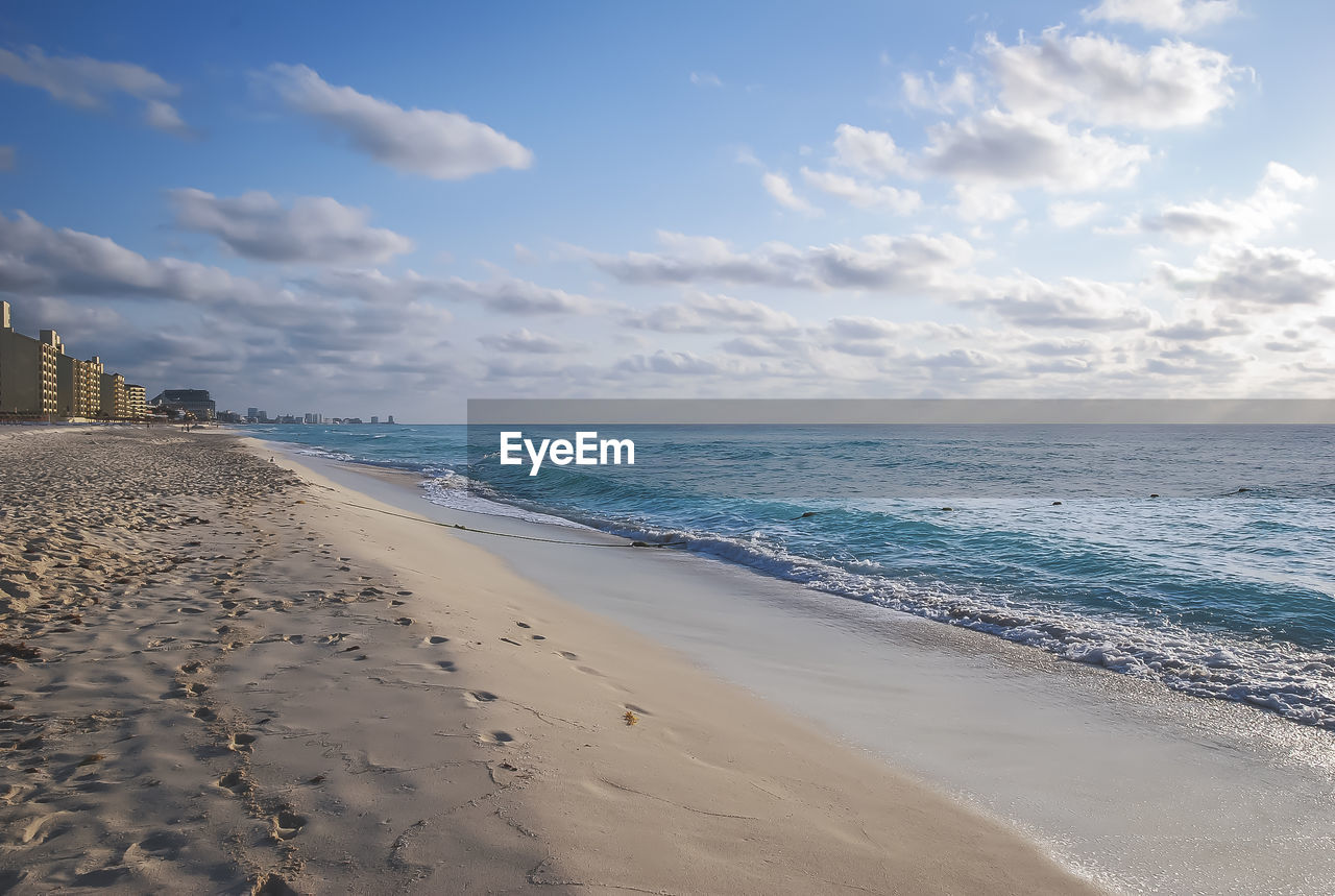 sea, beach, sand, water, sky, horizon over water, scenics, beauty in nature, nature, tranquil scene, tranquility, cloud - sky, no people, outdoors, day