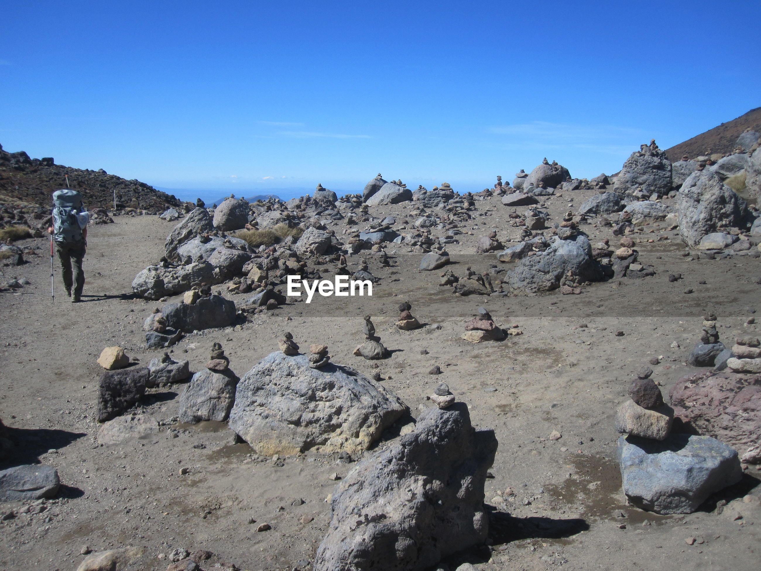PANORAMIC VIEW OF ROCKS ON LAND AGAINST CLEAR SKY