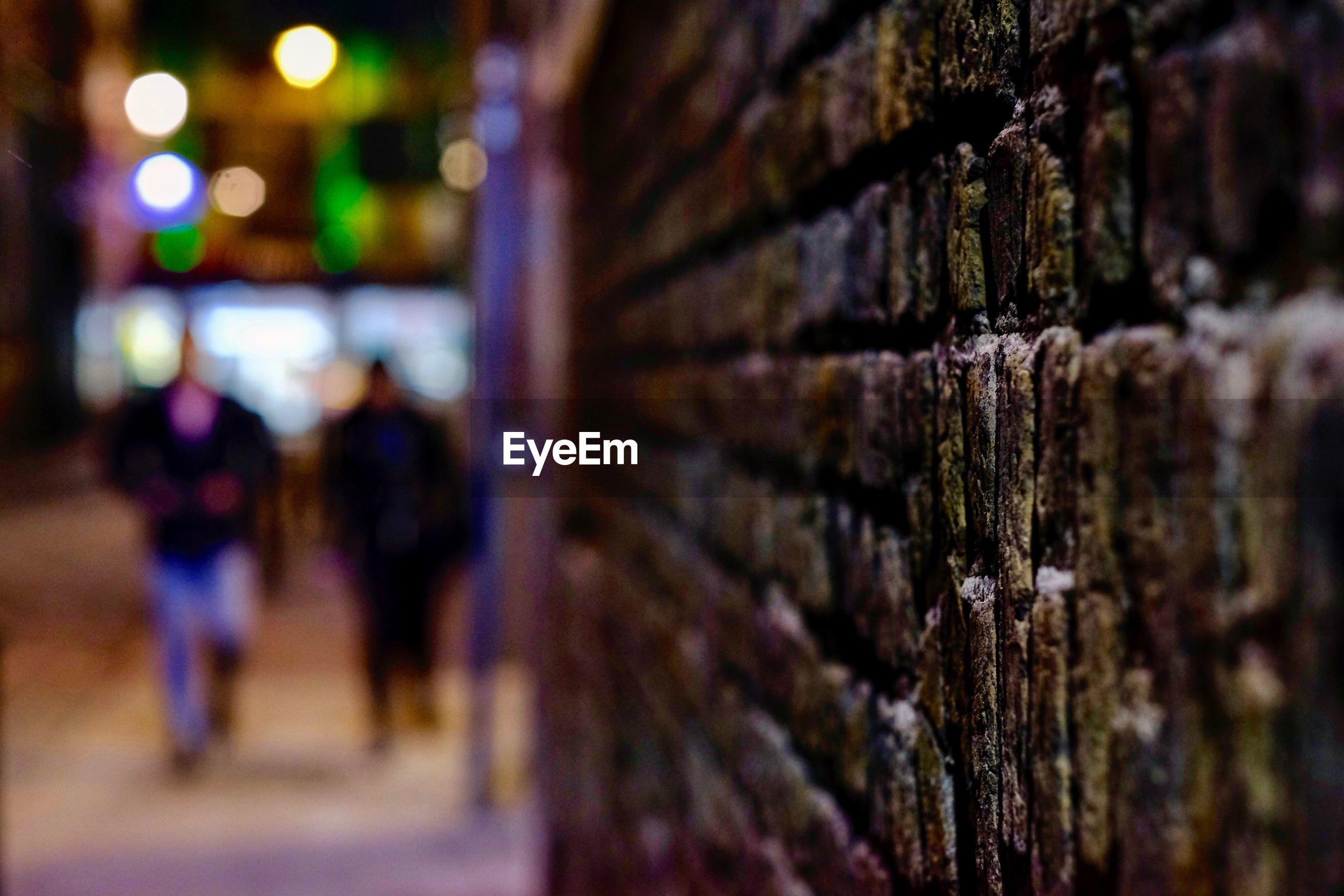 Close-up of brick wall at night