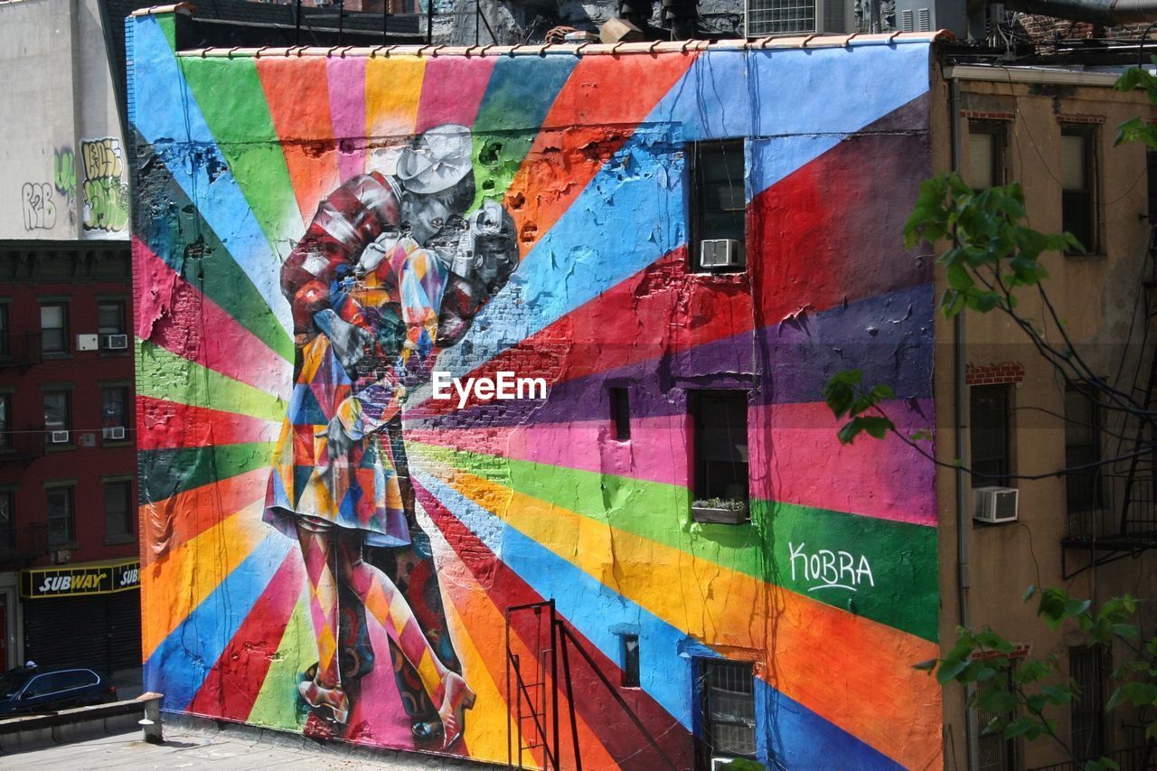 multi colored, architecture, building exterior, built structure, art and craft, city, building, graffiti, creativity, wall - building feature, day, no people, outdoors, mural, text, street, paint, residential district, street art, window