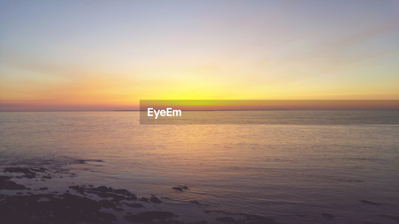 sea, sunset, scenics, beauty in nature, tranquility, tranquil scene, nature, horizon over water, water, idyllic, sky, beach, no people, outdoors, clear sky, day