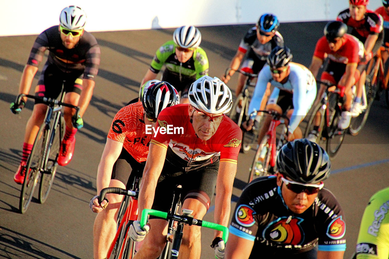 group of people, real people, competition, sport, helmet, lifestyles, headwear, men, transportation, people, clothing, sports race, leisure activity, sports clothing, bicycle, sports helmet, competitive sport, focus on foreground, day
