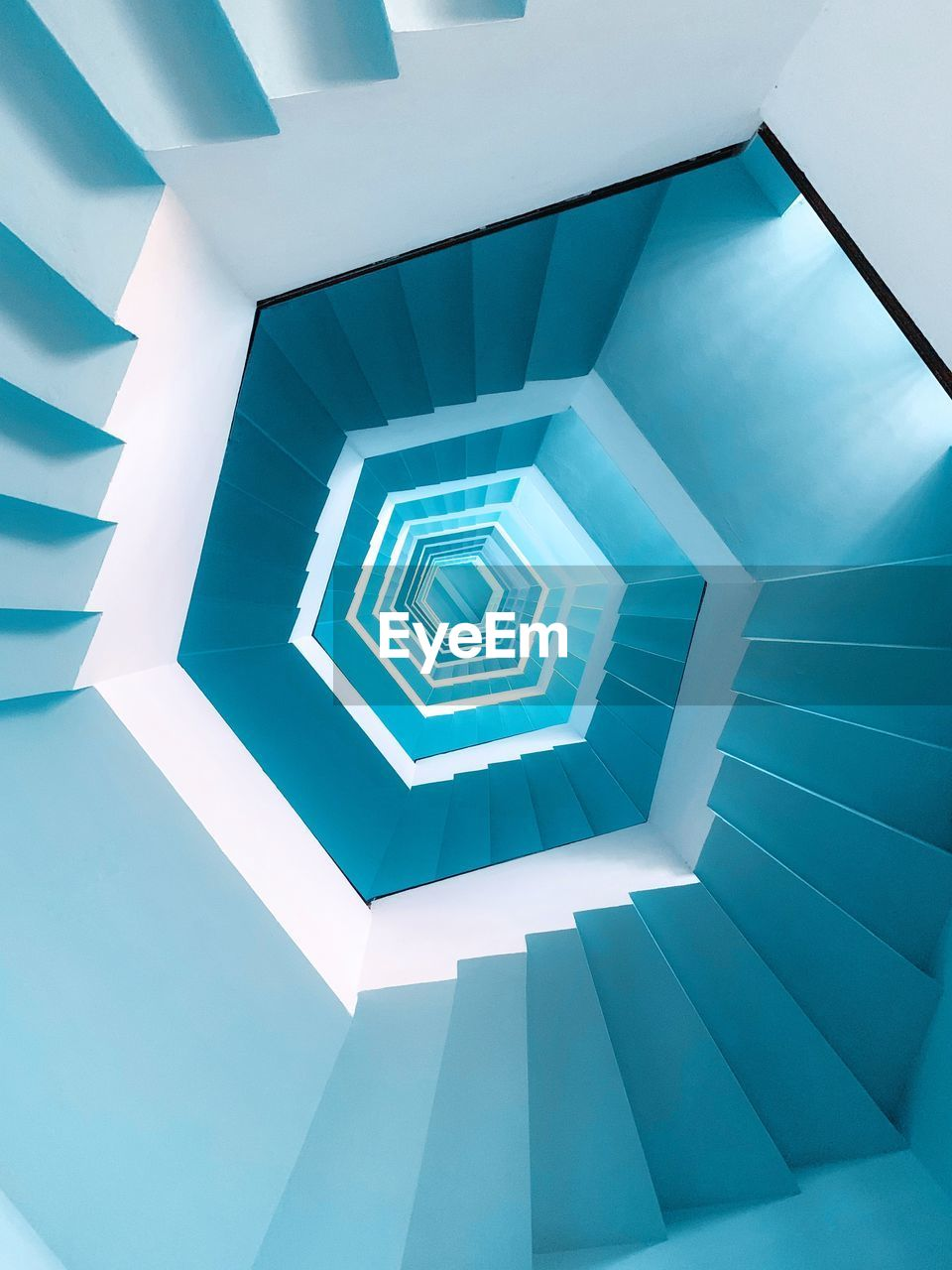 architecture, built structure, pattern, indoors, no people, steps and staircases, staircase, spiral, design, low angle view, geometric shape, shape, railing, repetition, building, diminishing perspective, spiral staircase, blue, directly below, abstract, ceiling