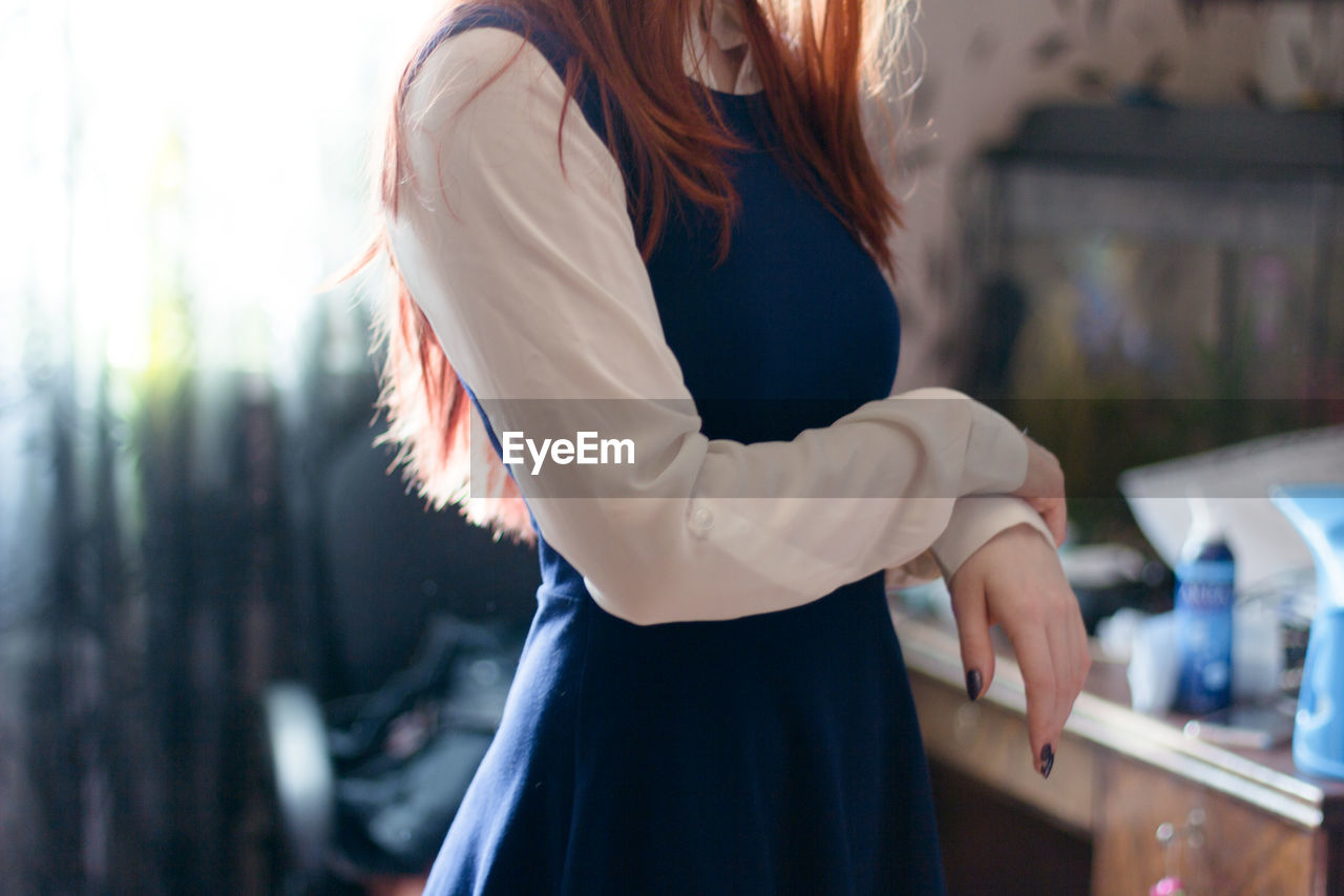 Midsection Of Young Woman Indoors