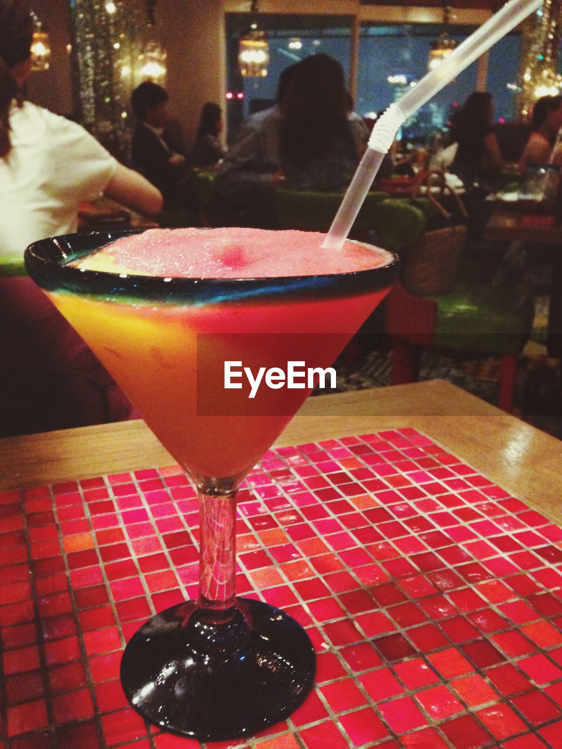 food and drink, table, freshness, drink, indoors, food, restaurant, refreshment, drinking glass, incidental people, sweet food, indulgence, sidewalk cafe, unhealthy eating, dessert, cafe, red, still life