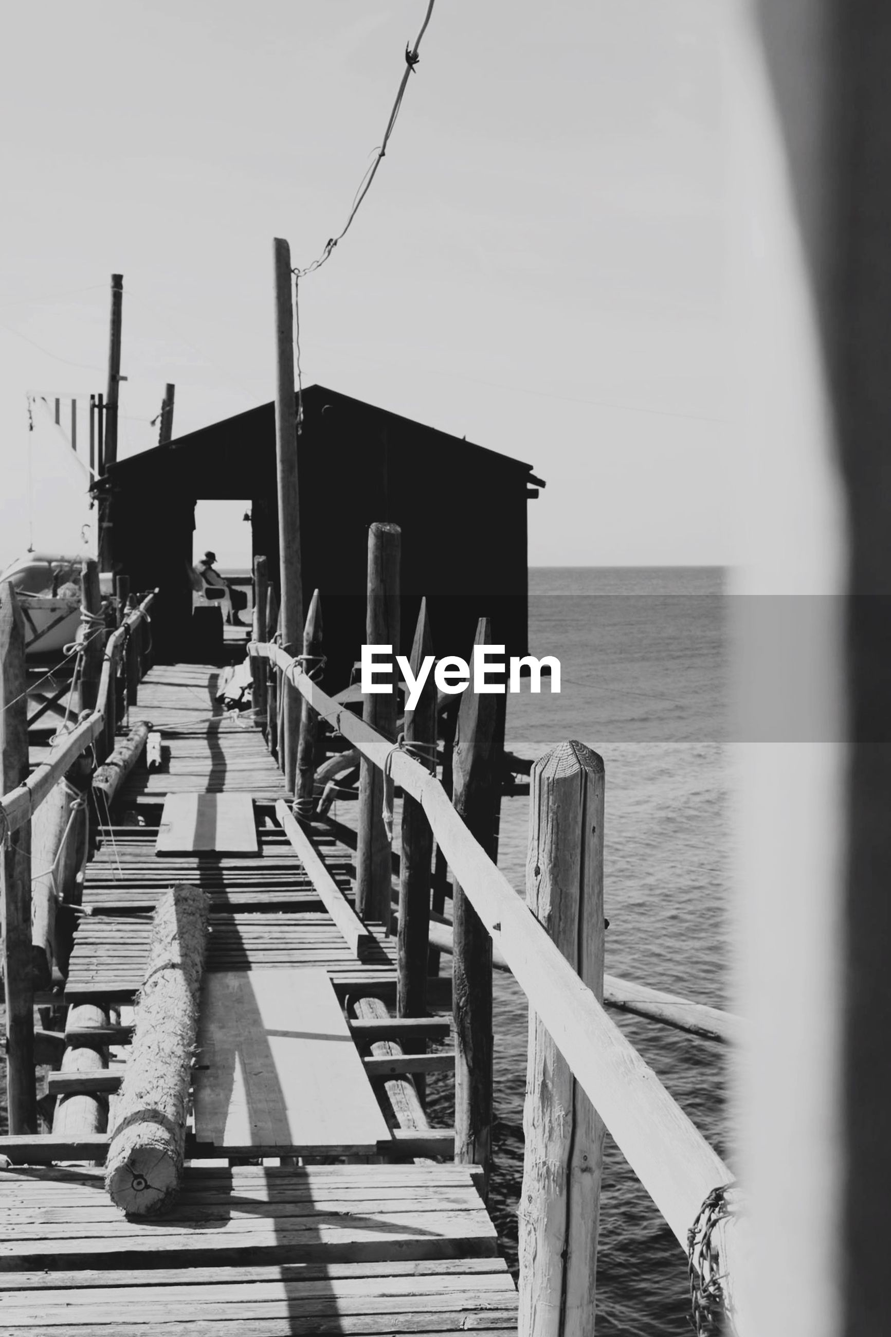 sea, wood - material, pier, water, railing, sky, horizon over water, built structure, wooden, wood, tranquility, nature, architecture, jetty, outdoors, day, tranquil scene, the way forward, boardwalk, no people