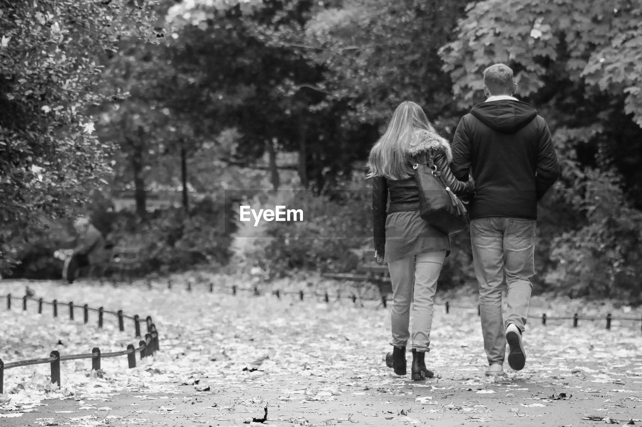 Full Length Rear View Of Man And Woman Walking At St Stephen Green