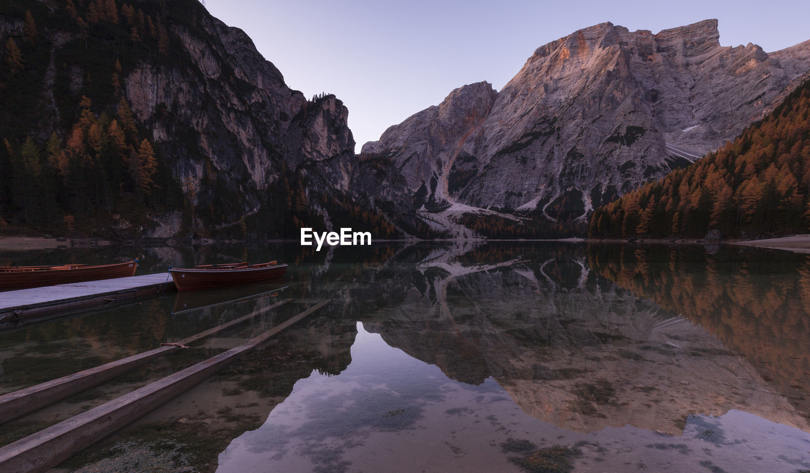 Reflection of mountains in lake against sky at lago di braies in dolomites mountains