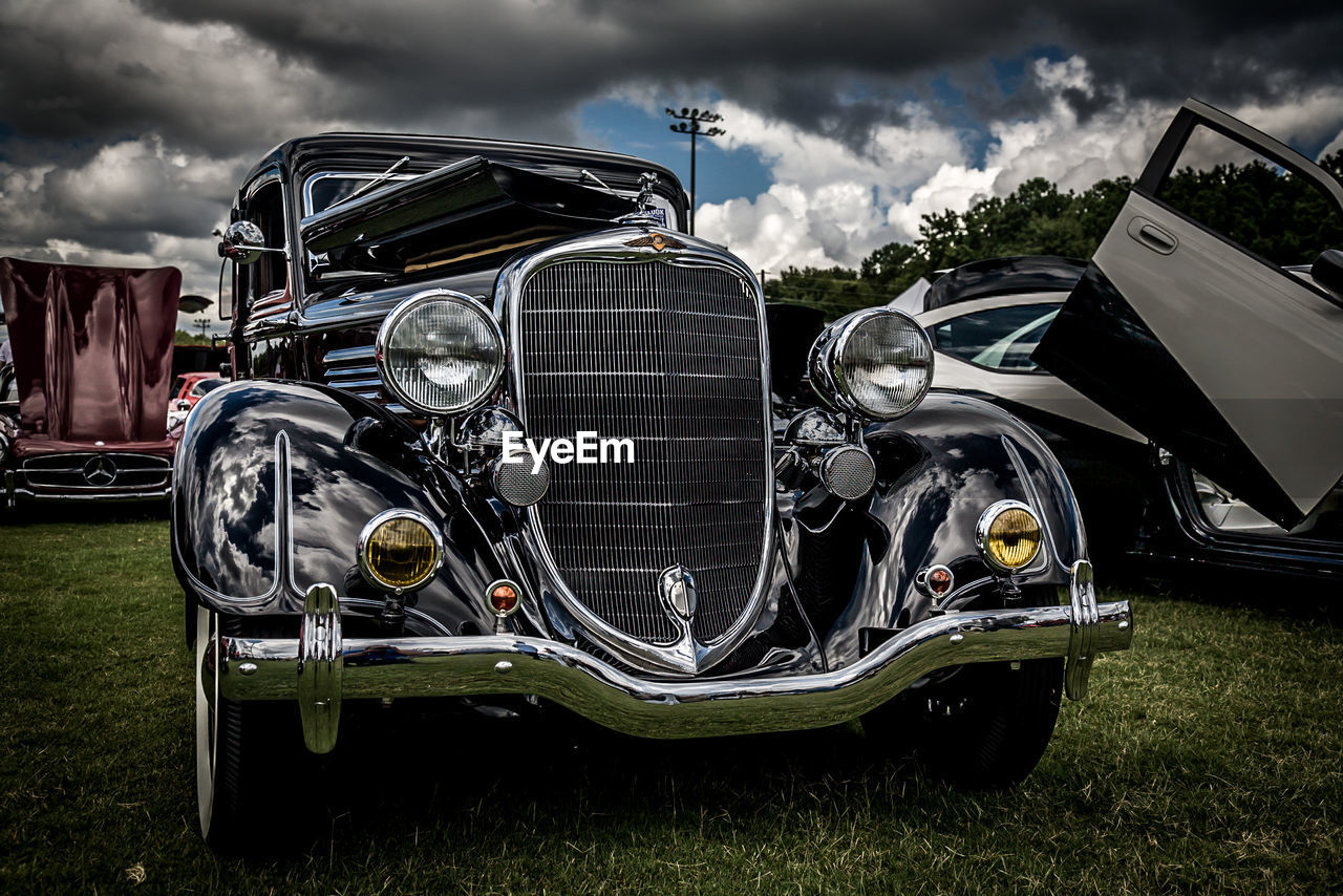 transportation, cloud - sky, headlight, mode of transport, old-fashioned, car, land vehicle, retro styled, field, sky, abandoned, outdoors, no people, day, grass, close-up