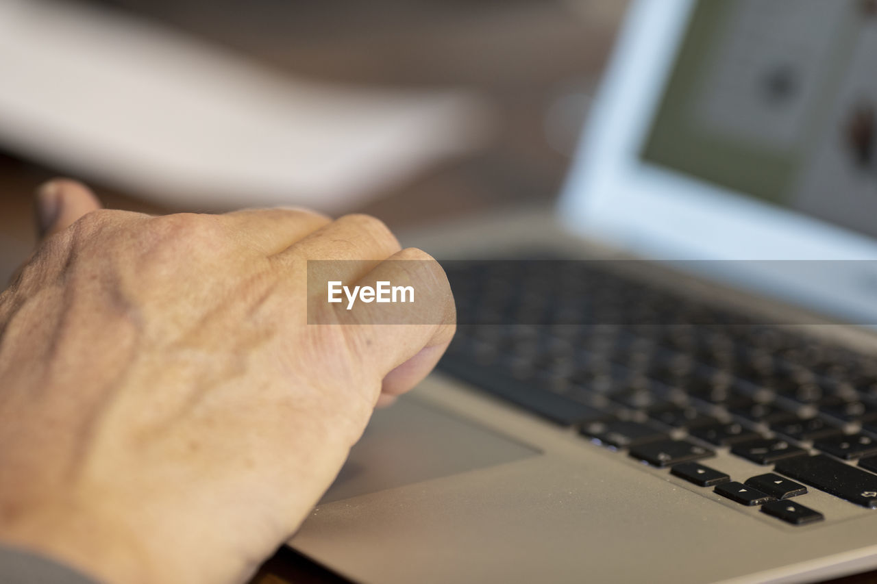 computer, technology, laptop, human hand, hand, wireless technology, computer equipment, communication, human body part, keyboard, connection, computer keyboard, one person, indoors, using laptop, close-up, typing, selective focus, real people, adult, computer key, surfing the net, finger, human limb