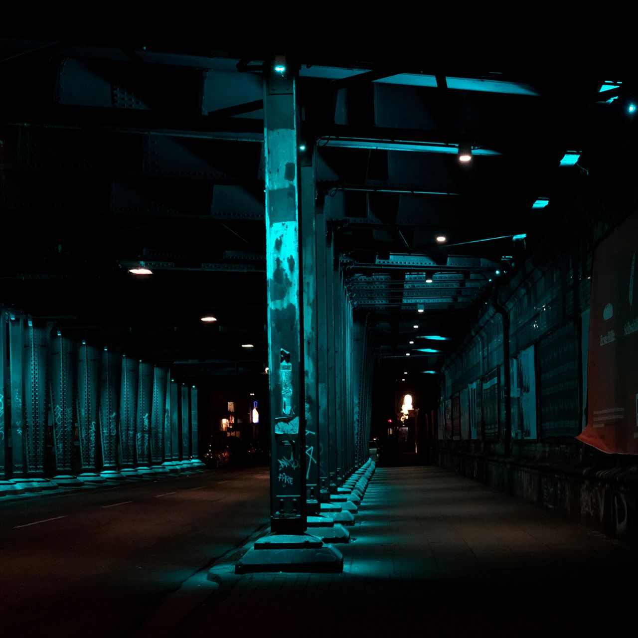 architecture, the way forward, direction, built structure, illuminated, lighting equipment, transportation, night, no people, architectural column, in a row, road, empty, building, city, footpath, outdoors, bridge, light, ceiling, long