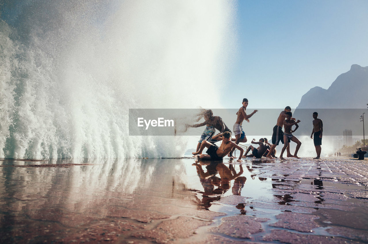 water, group of people, men, sea, motion, nature, real people, vacations, leisure activity, splashing, trip, lifestyles, holiday, sky, day, enjoyment, people, scenics - nature, waterfront, power in nature, outdoors
