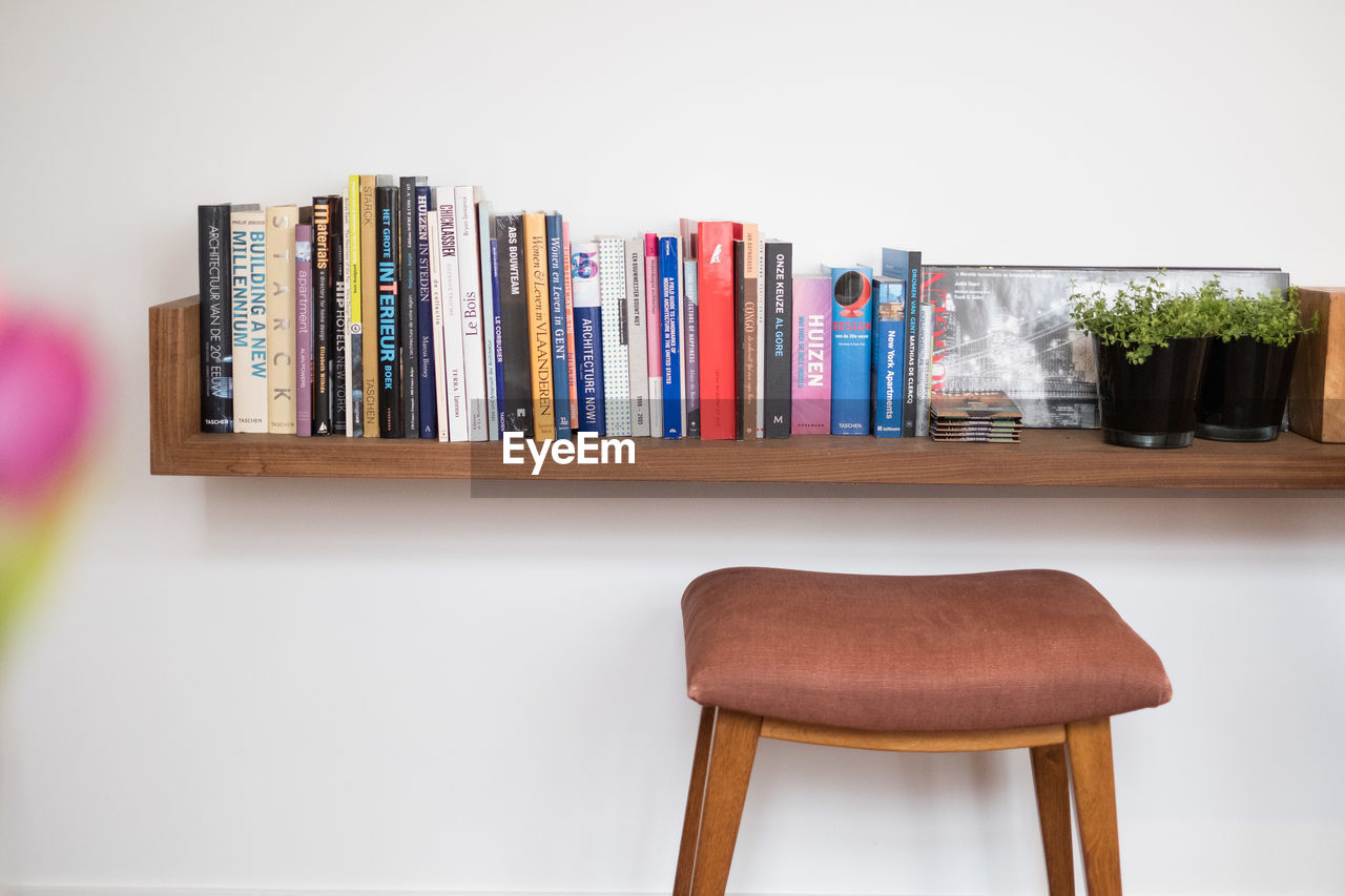 CLOSE-UP OF BOOKS ON TABLE IN HOME