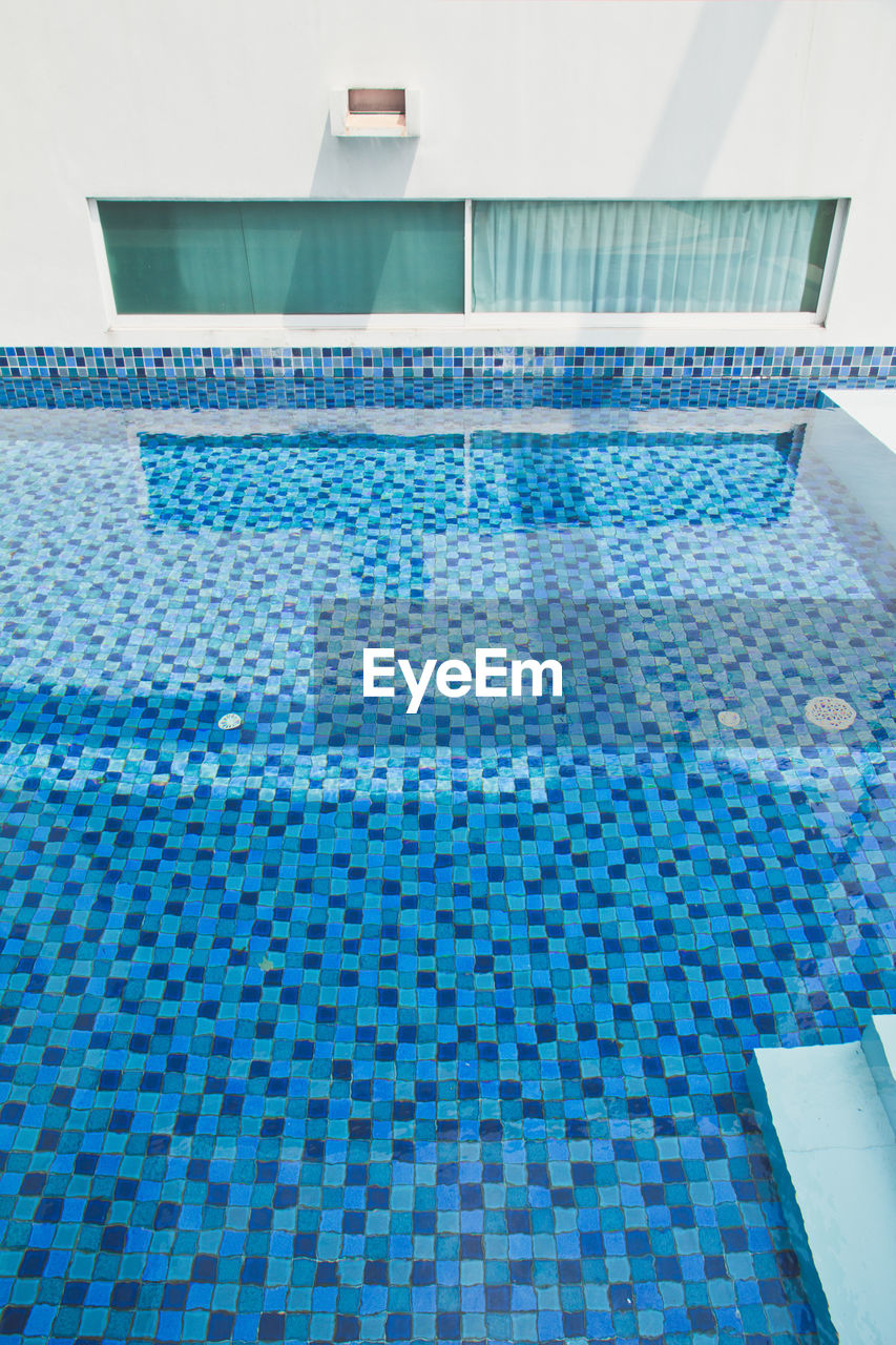 swimming pool, pool, blue, poolside, tile, water, flooring, day, architecture, no people, nature, pattern, high angle view, tourist resort, waterfront, relaxation, built structure, luxury, summer, tiled floor, turquoise colored