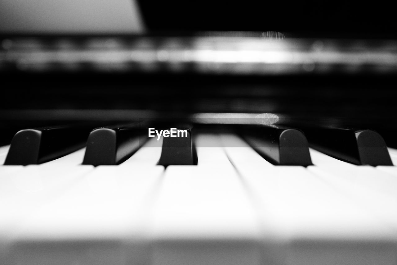 music, musical instrument, piano key, piano, musical equipment, arts culture and entertainment, close-up, no people, black color, synthesizer, indoors, recording studio, day, keyboard