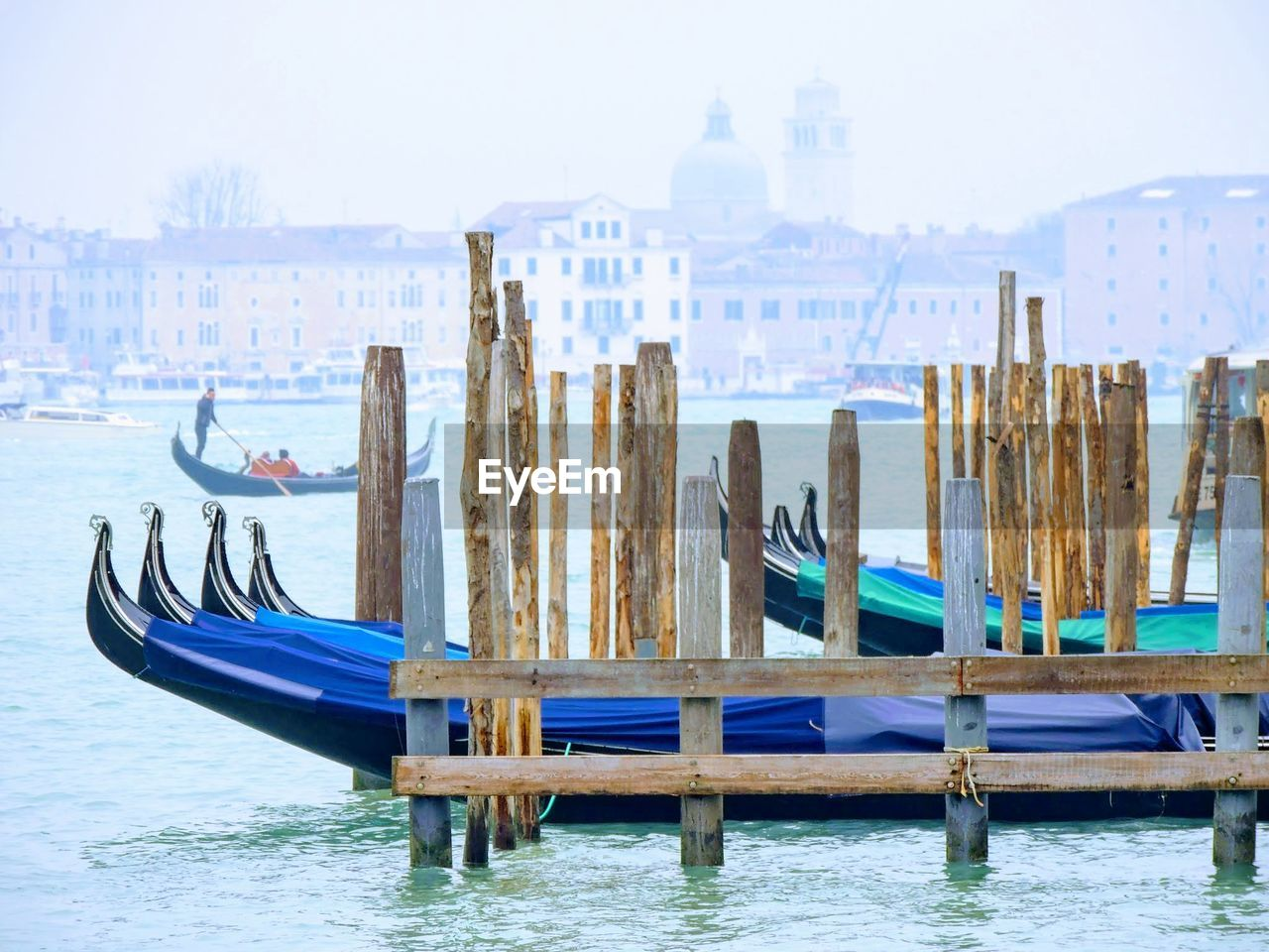 water, built structure, nautical vessel, transportation, no people, wood - material, architecture, wooden post, day, mode of transportation, nature, post, blue, moored, building exterior, sky, focus on foreground, building, waterfront, canal