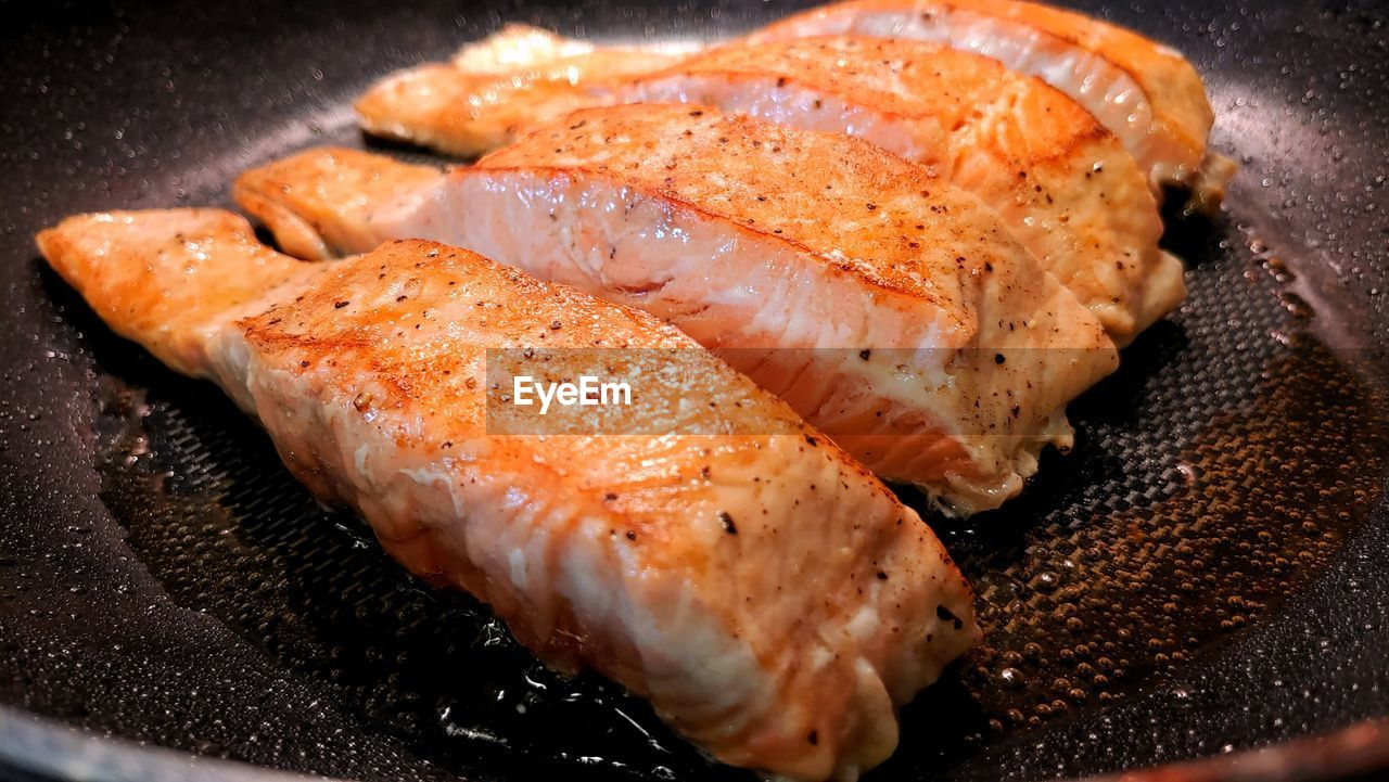 Close-up of salmon in cooking pan