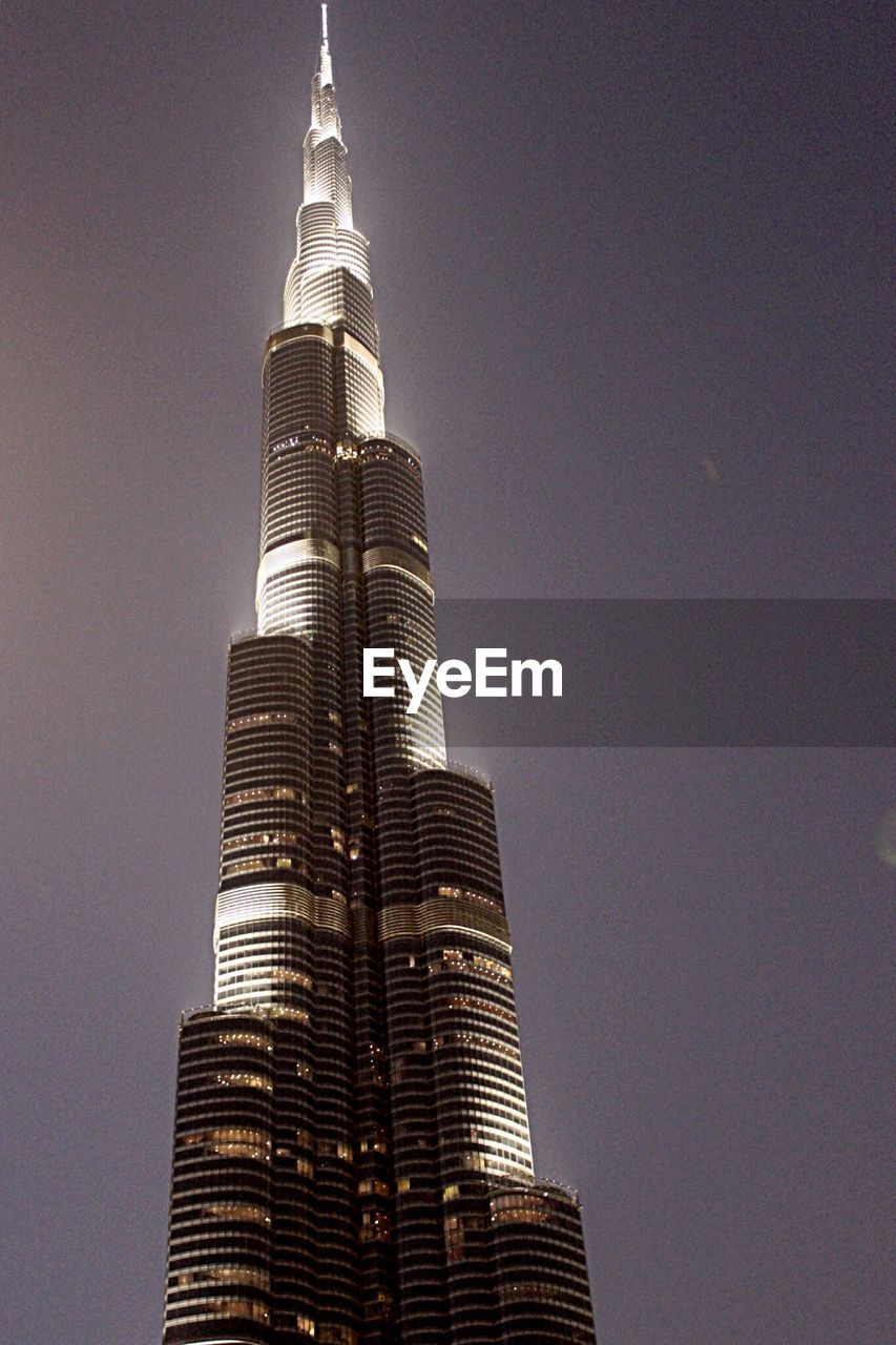 tall - high, skyscraper, architecture, low angle view, built structure, modern, building exterior, tower, travel destinations, no people, outdoors, night, city, clear sky, sky