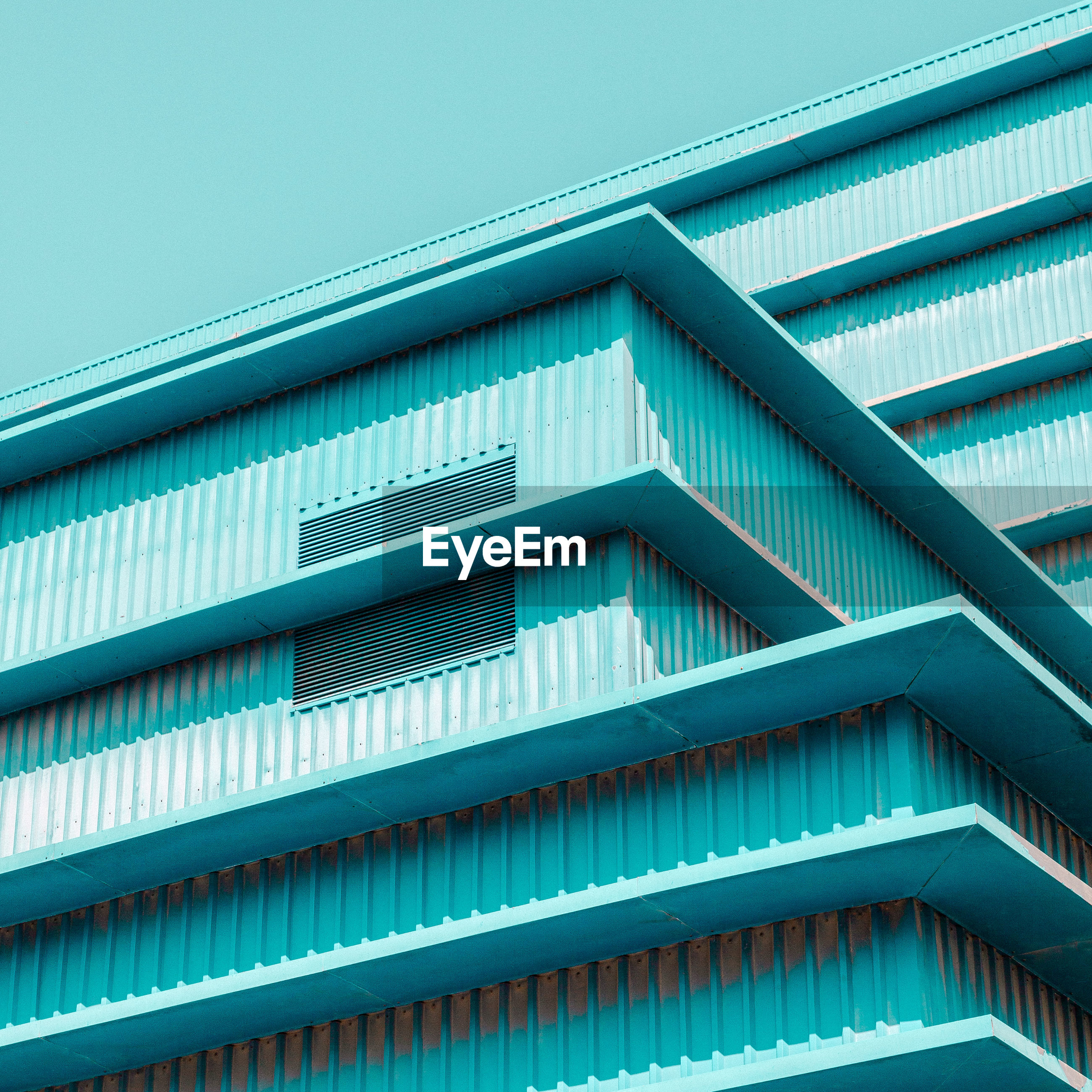 architecture, built structure, pattern, building exterior, low angle view, no people, blue, building, repetition, day, clear sky, full frame, sky, modern, nature, backgrounds, side by side, outdoors, sunlight, metal, turquoise colored