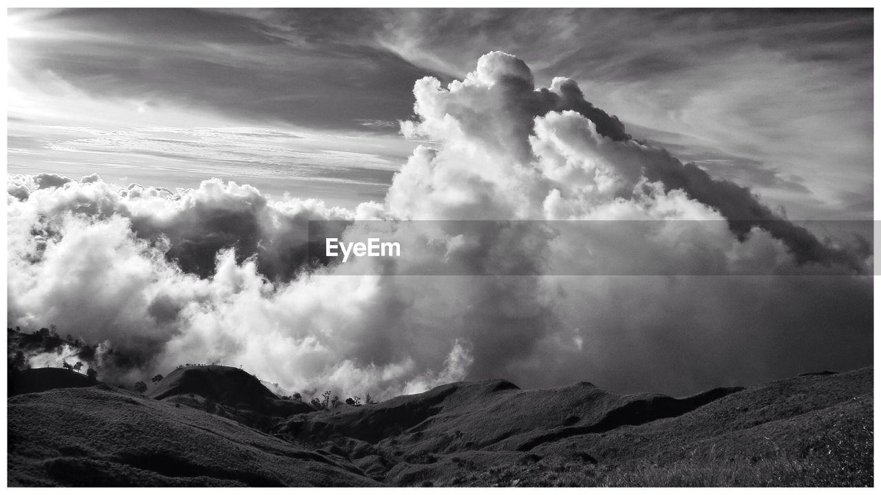 Cloudscape Above Rolling Landscape