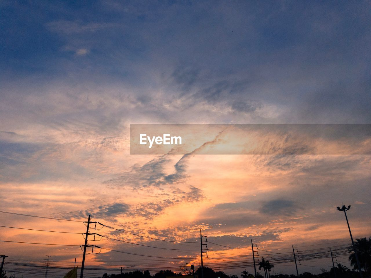 sunset, sky, cloud - sky, silhouette, cable, connection, no people, technology, electricity pylon, orange color, nature, power line, beauty in nature, power supply, scenics, low angle view, fuel and power generation, electricity, outdoors, telephone line, vapor trail, day