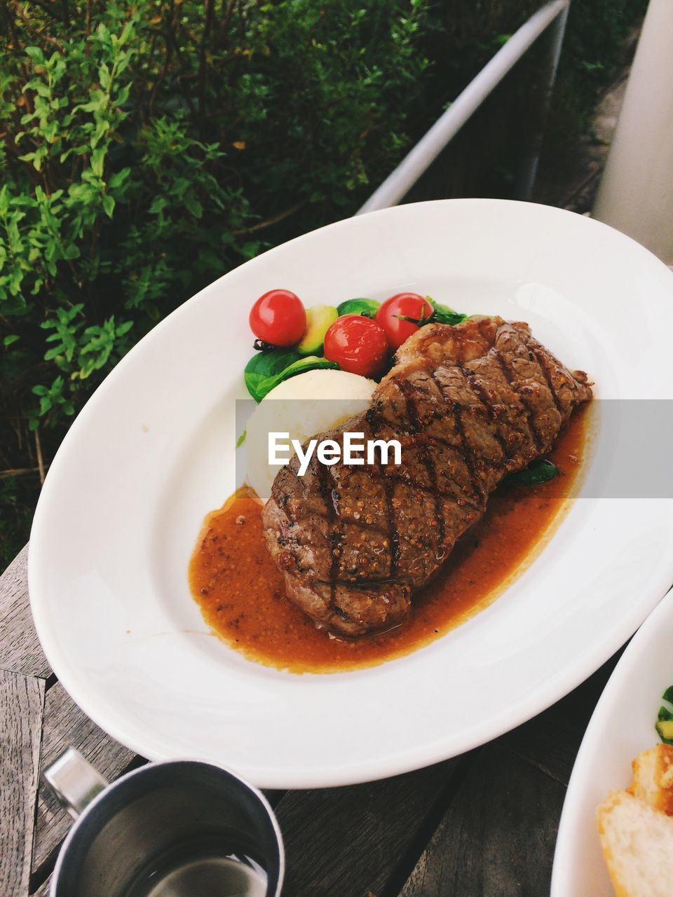 Beef and cherry tomatoes on plate