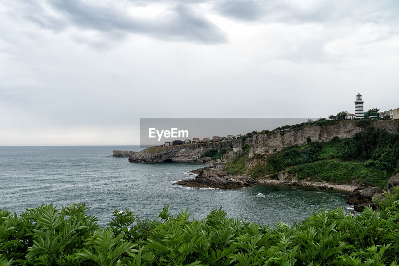 water, sky, beauty in nature, sea, scenics - nature, nature, tranquil scene, tranquility, plant, cloud - sky, land, day, growth, idyllic, no people, non-urban scene, horizon over water, architecture, rock, outdoors, rocky coastline
