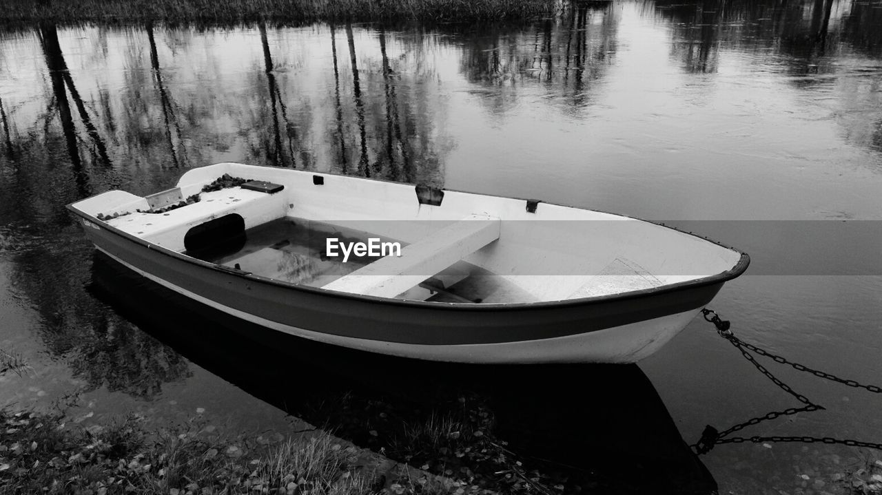 water, nautical vessel, lake, moored, nature, no people, transportation, high angle view, outdoors, day, tree, tranquility, rowboat, close-up