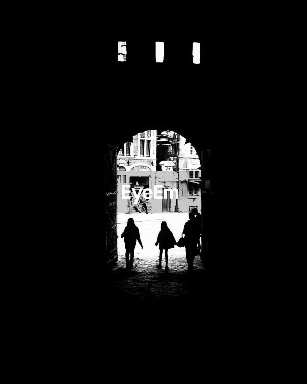 built structure, silhouette, architecture, real people, men, arch, building exterior, lifestyles, leisure activity, togetherness, walking, indoors, day, women, city, people