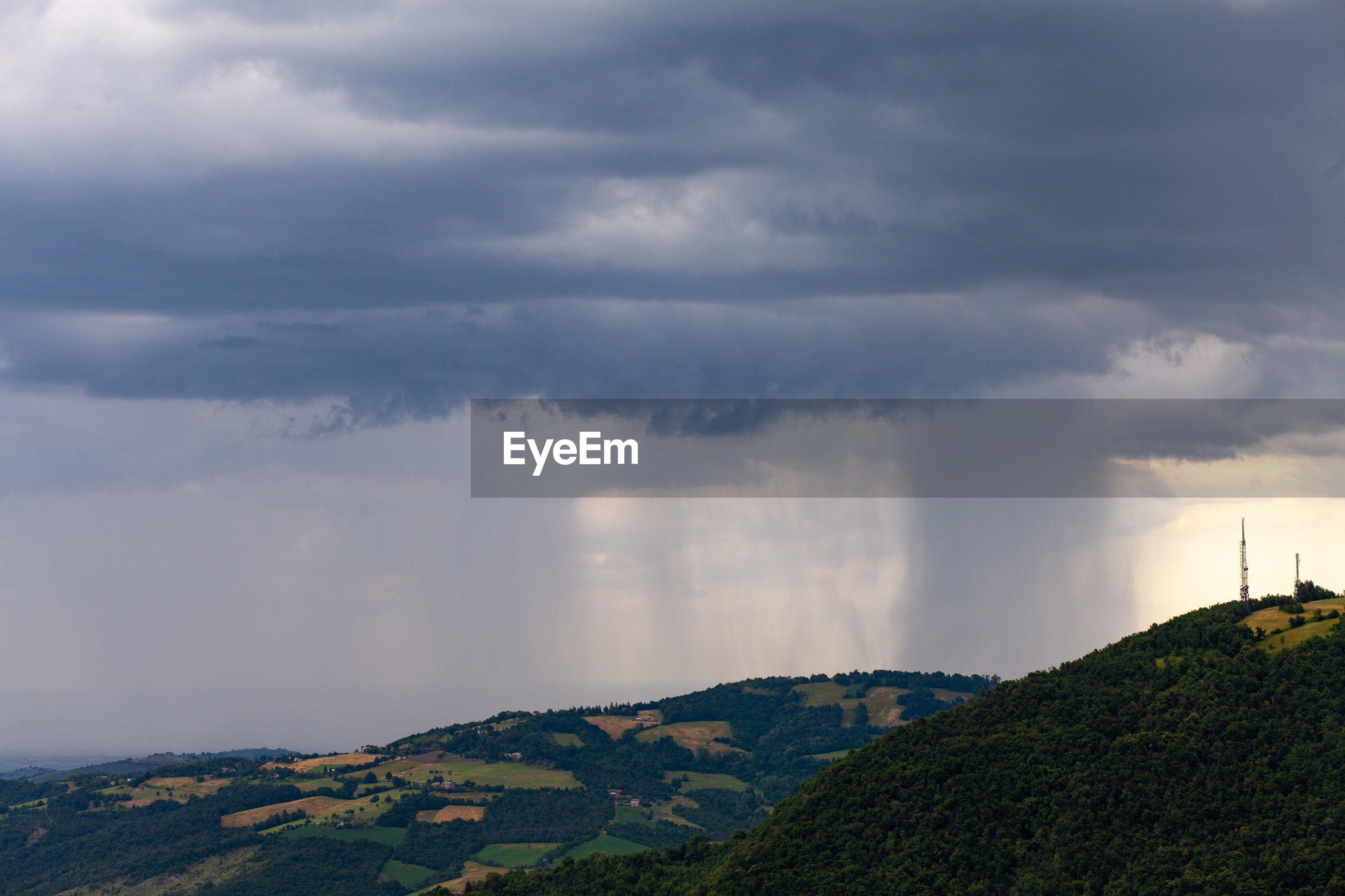 A storm on modena plain seen from little city of serramazzoni on the hills