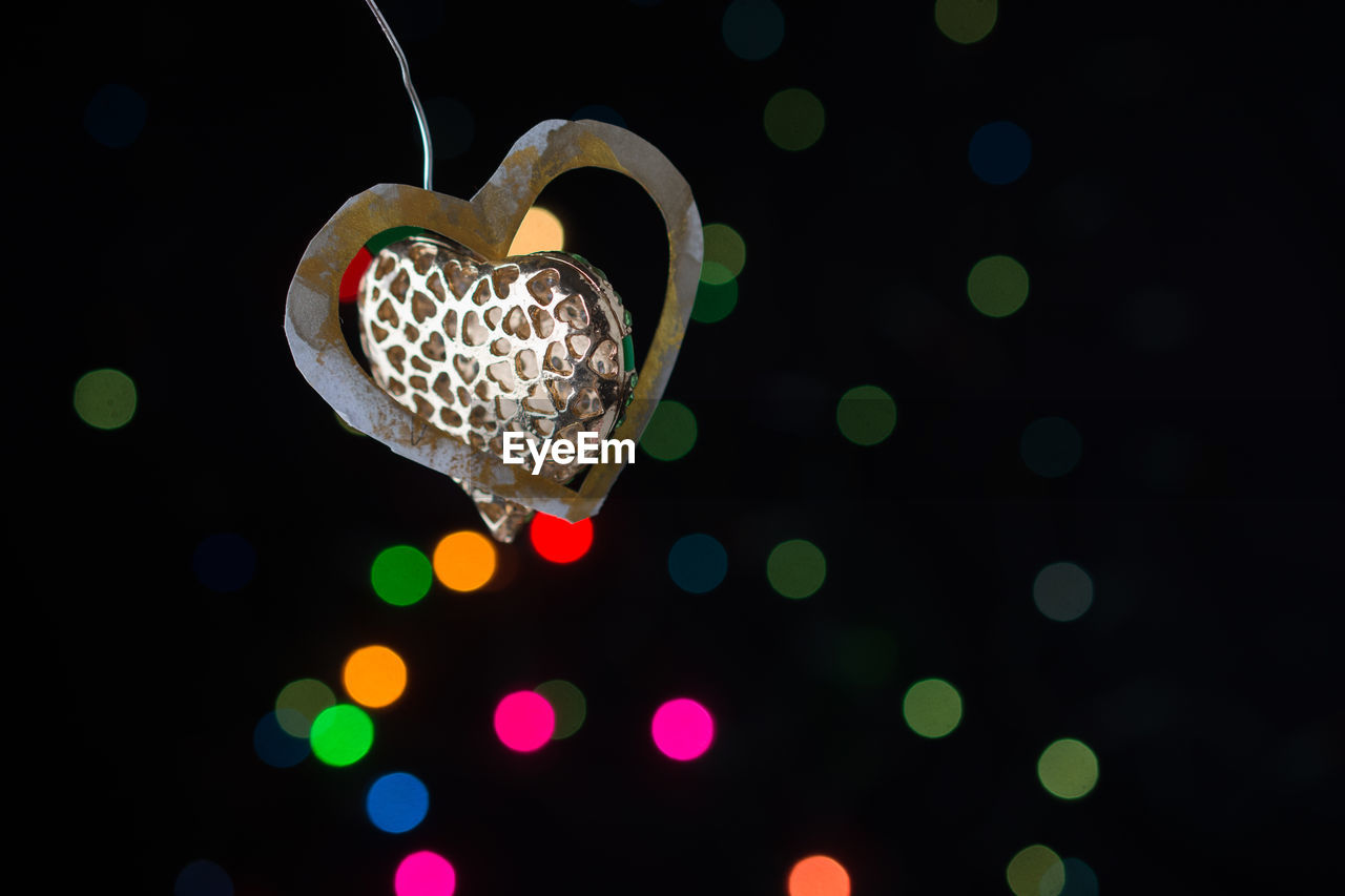 heart shape, love, no people, close-up, emotion, illuminated, positive emotion, night, decoration, still life, indoors, design, multi colored, shape, celebration, pattern, hanging, lighting equipment, creativity, christmas, black background