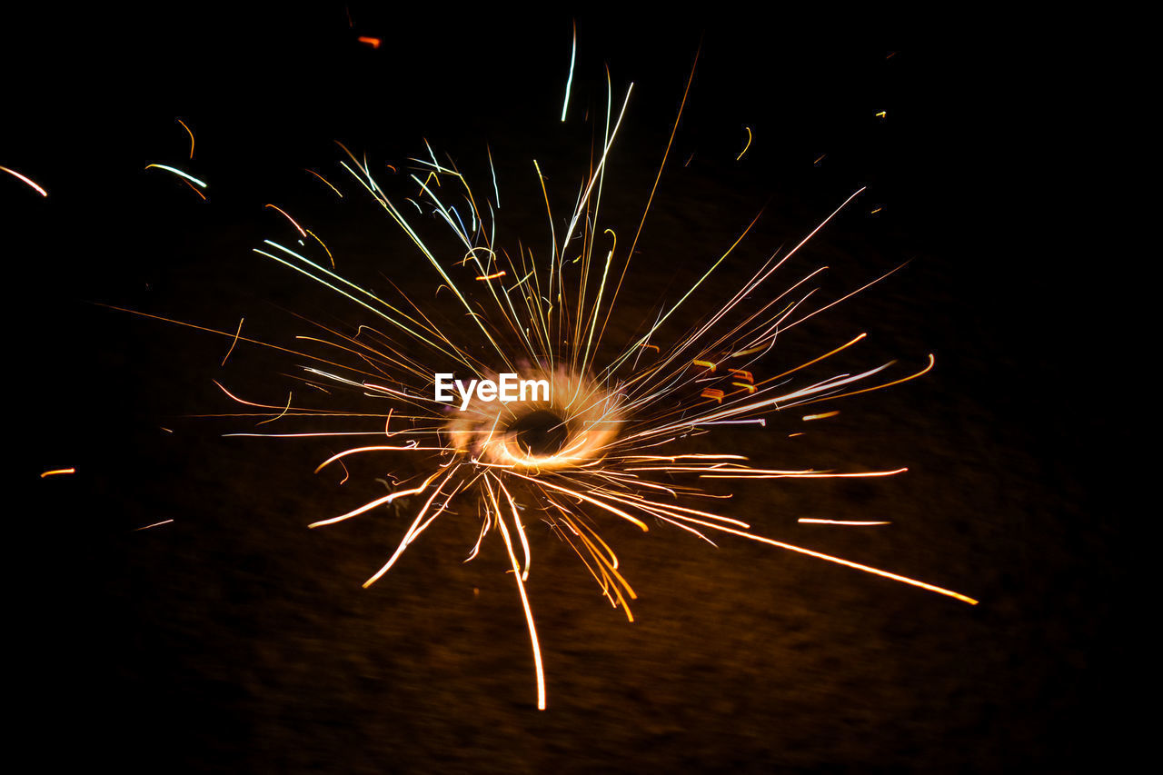 illuminated, motion, night, glowing, long exposure, firework, celebration, event, blurred motion, burning, no people, close-up, arts culture and entertainment, firework - man made object, sparks, sparkler, nature, light, firework display, exploding, dark