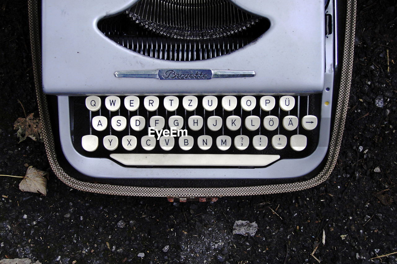 text, number, typewriter, old-fashioned, high angle view, alphabet, obsolete, no people, technology, communication, close-up, retro styled, machinery, day, outdoors, computer key