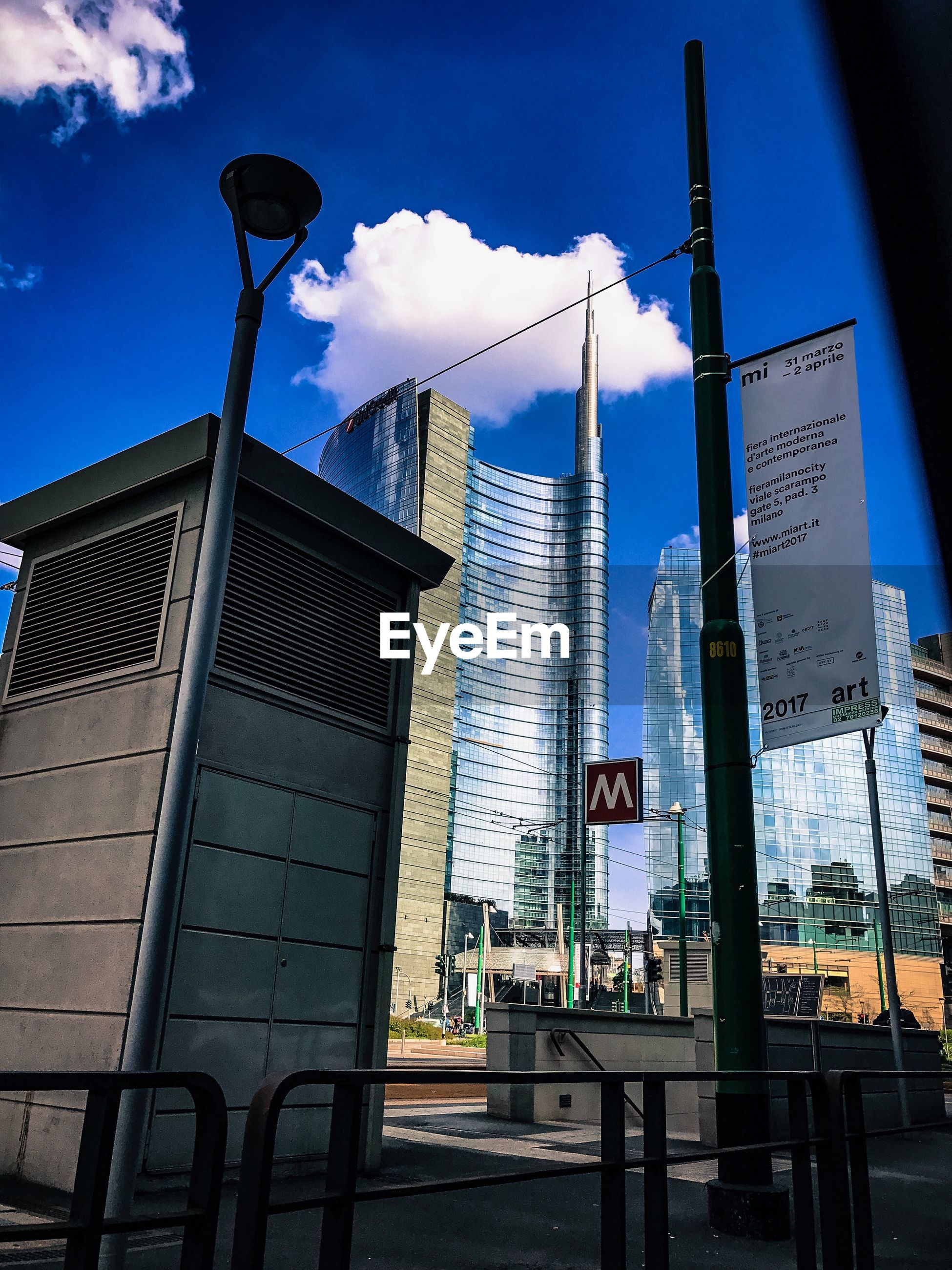 architecture, built structure, city, low angle view, sky, skyscraper, blue, building exterior, no people, tower, outdoors, day