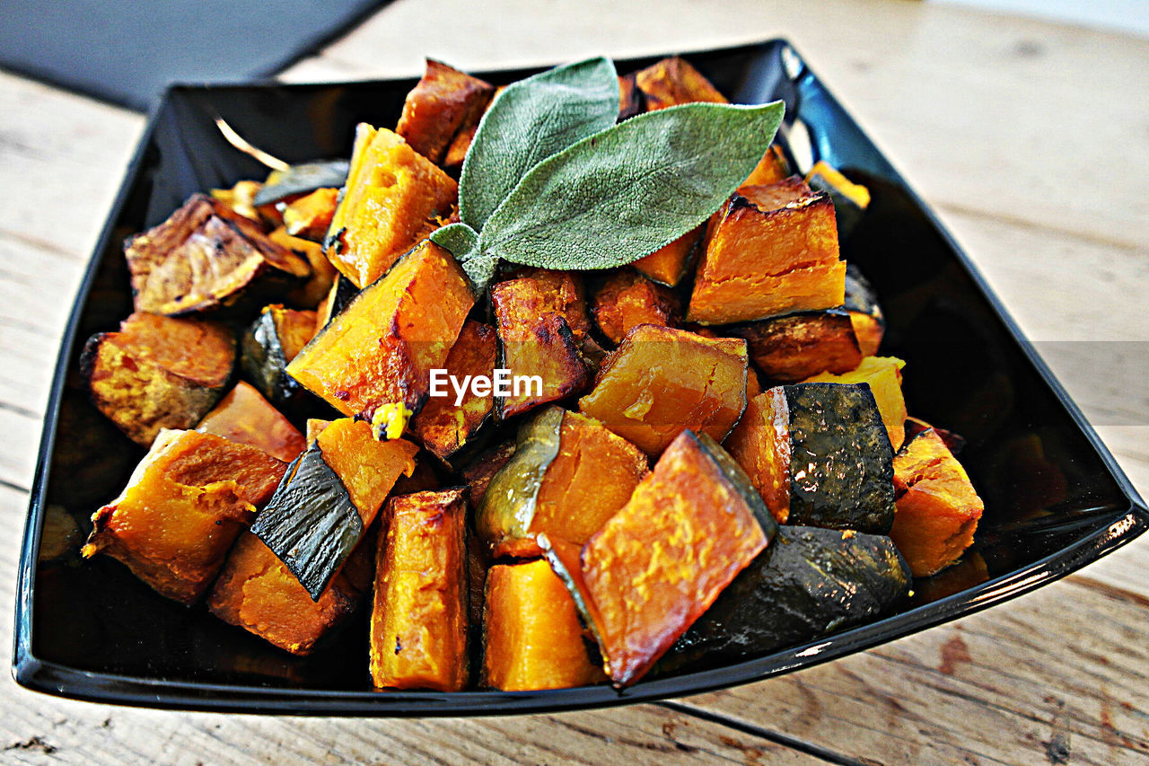 High angle view of cooked pumpkins in plate on table