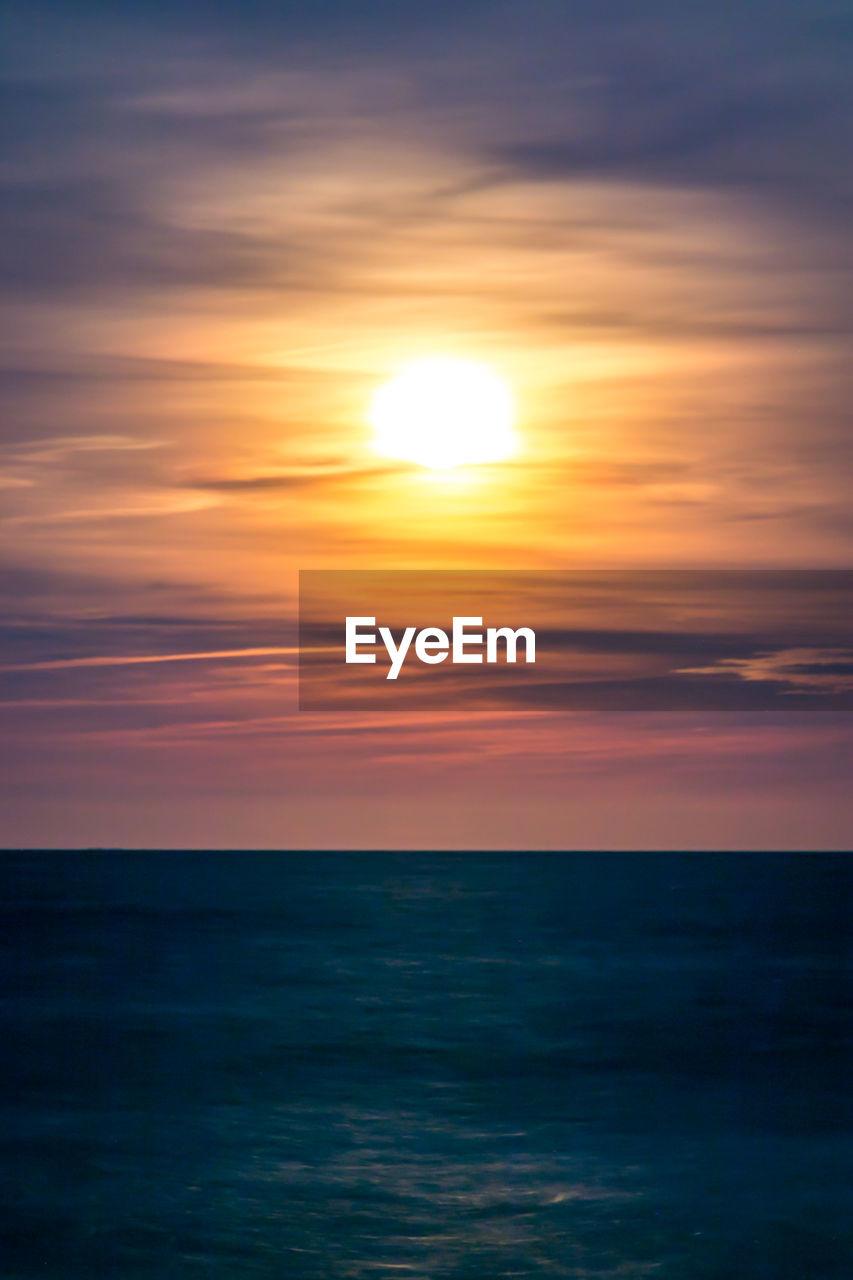 sea, sunset, beauty in nature, scenics, horizon over water, water, sun, tranquil scene, nature, tranquility, sky, idyllic, no people, reflection, sunlight, outdoors, cloud - sky, silhouette, day