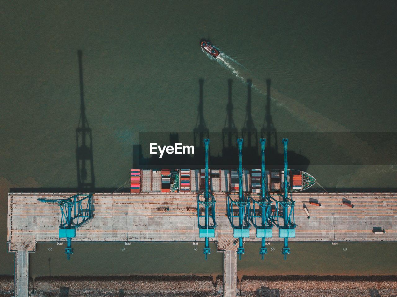 Aerial View Of Crane At Harbor