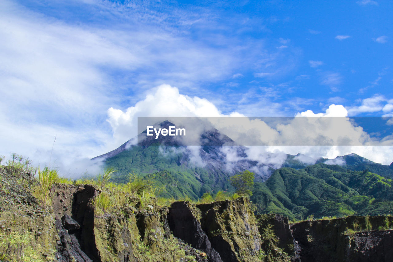 mountain, sky, cloud - sky, beauty in nature, scenics - nature, tranquil scene, mountain range, tranquility, nature, no people, non-urban scene, day, environment, rock, landscape, idyllic, geology, outdoors, physical geography, travel destinations, mountain peak, formation, volcanic crater