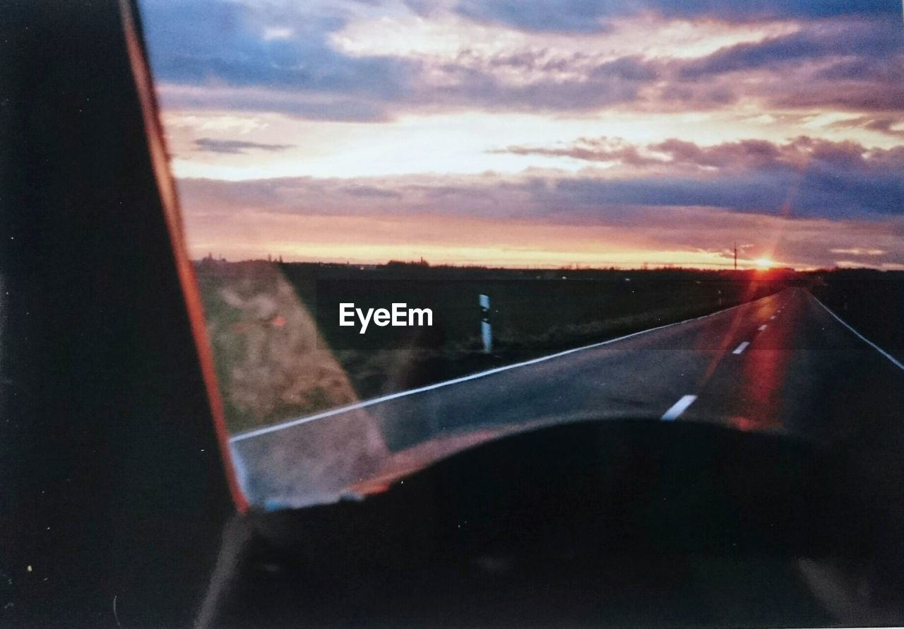 VIEW OF ROAD THROUGH CAR WINDSHIELD