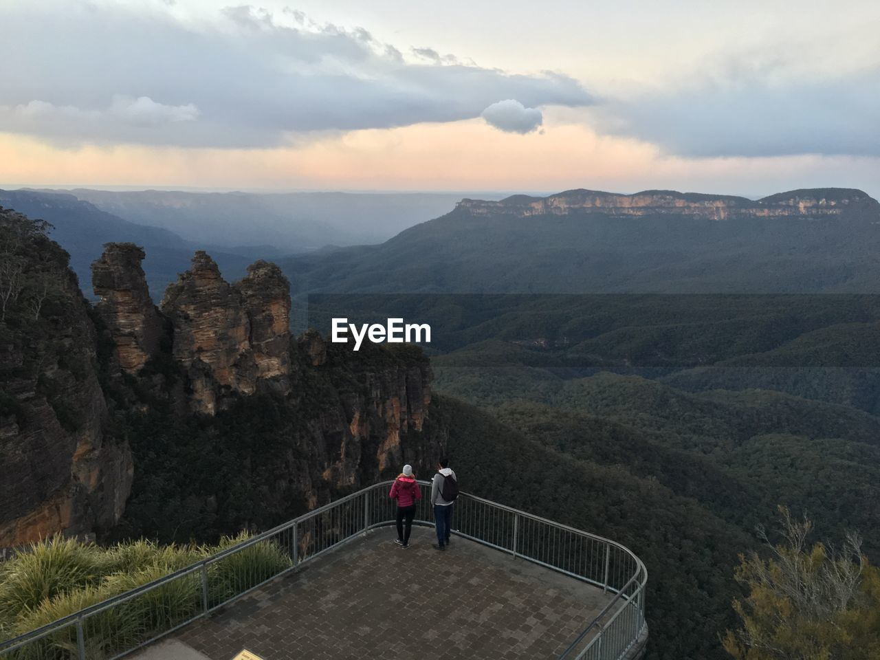 High Angle View Of Friends Standing At Observation Point