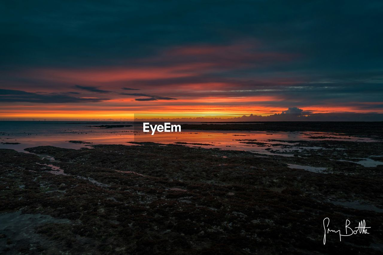 sunset, scenics, sky, beauty in nature, tranquil scene, nature, beach, orange color, tranquility, sea, cloud - sky, water, outdoors, sand, no people, horizon over water, landscape, day