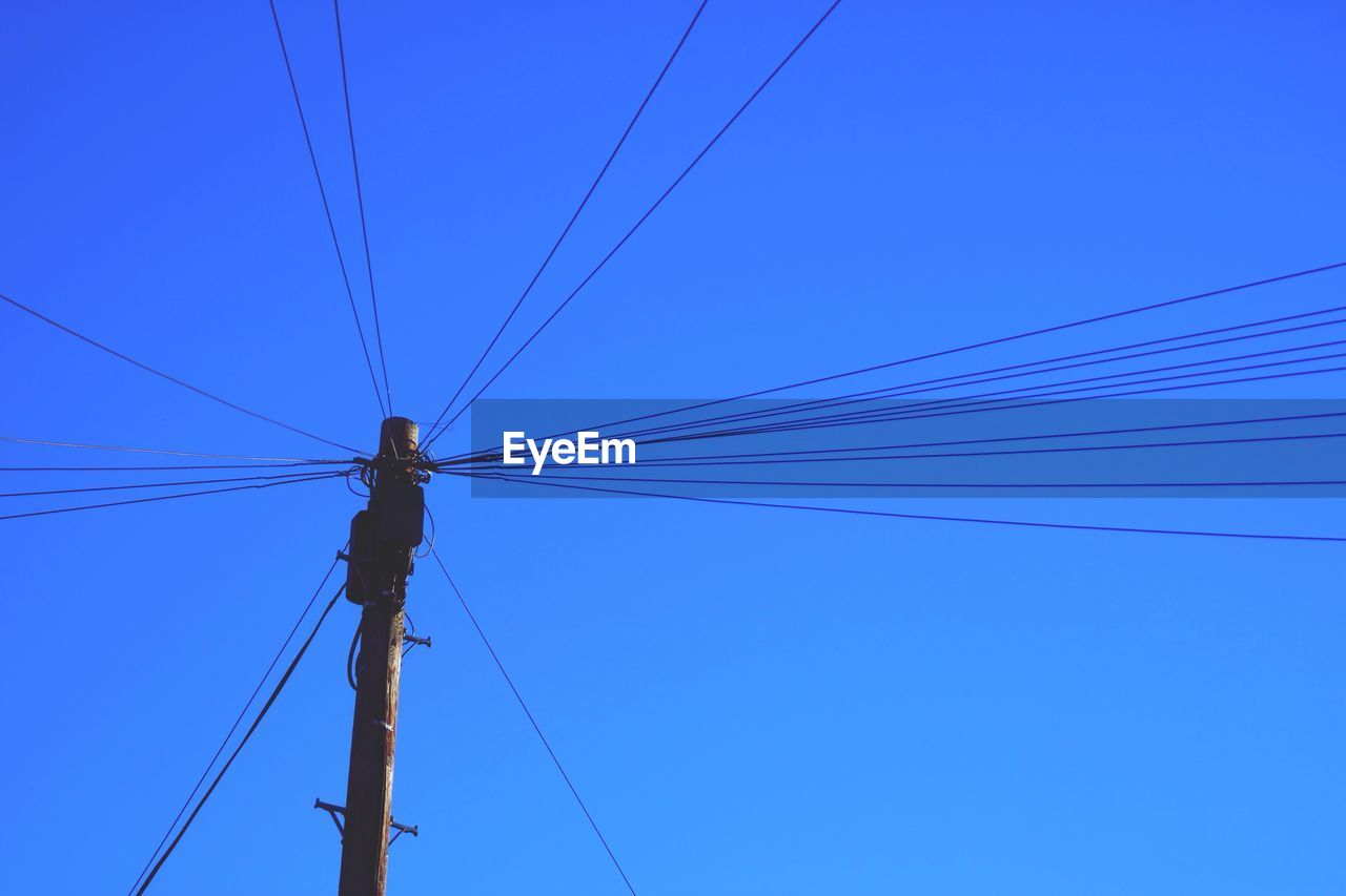 cable, power line, power supply, connection, electricity, fuel and power generation, blue, technology, low angle view, electricity pylon, day, outdoors, telephone line, no people, complexity, clear sky