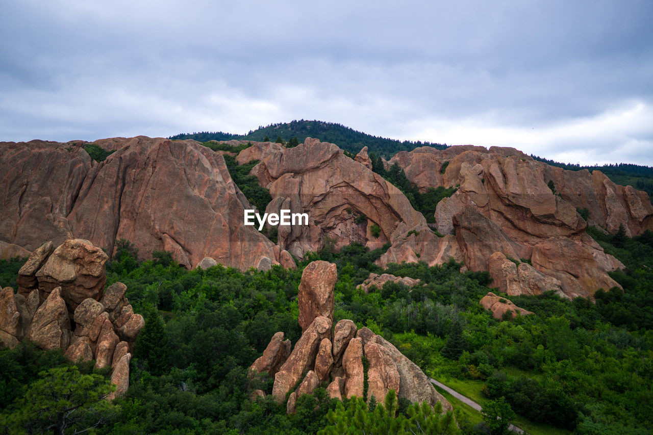 sky, mountain, cloud - sky, rock, beauty in nature, scenics - nature, solid, rock - object, tranquil scene, landscape, mountain range, environment, non-urban scene, nature, rock formation, tranquility, physical geography, plant, geology, remote, no people, formation, outdoors, eroded, arid climate, mountain peak