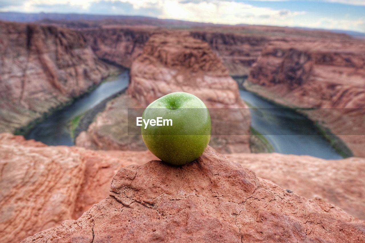 Green Apple On Edge Of Canyon