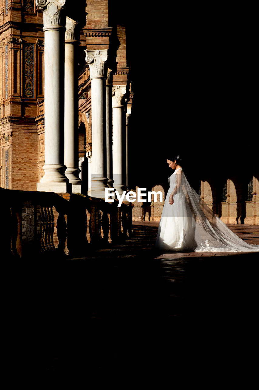 architecture, built structure, wedding, event, celebration, bride, building exterior, real people, newlywed, religion, women, love, architectural column, life events, place of worship, nature, men, outdoors, night